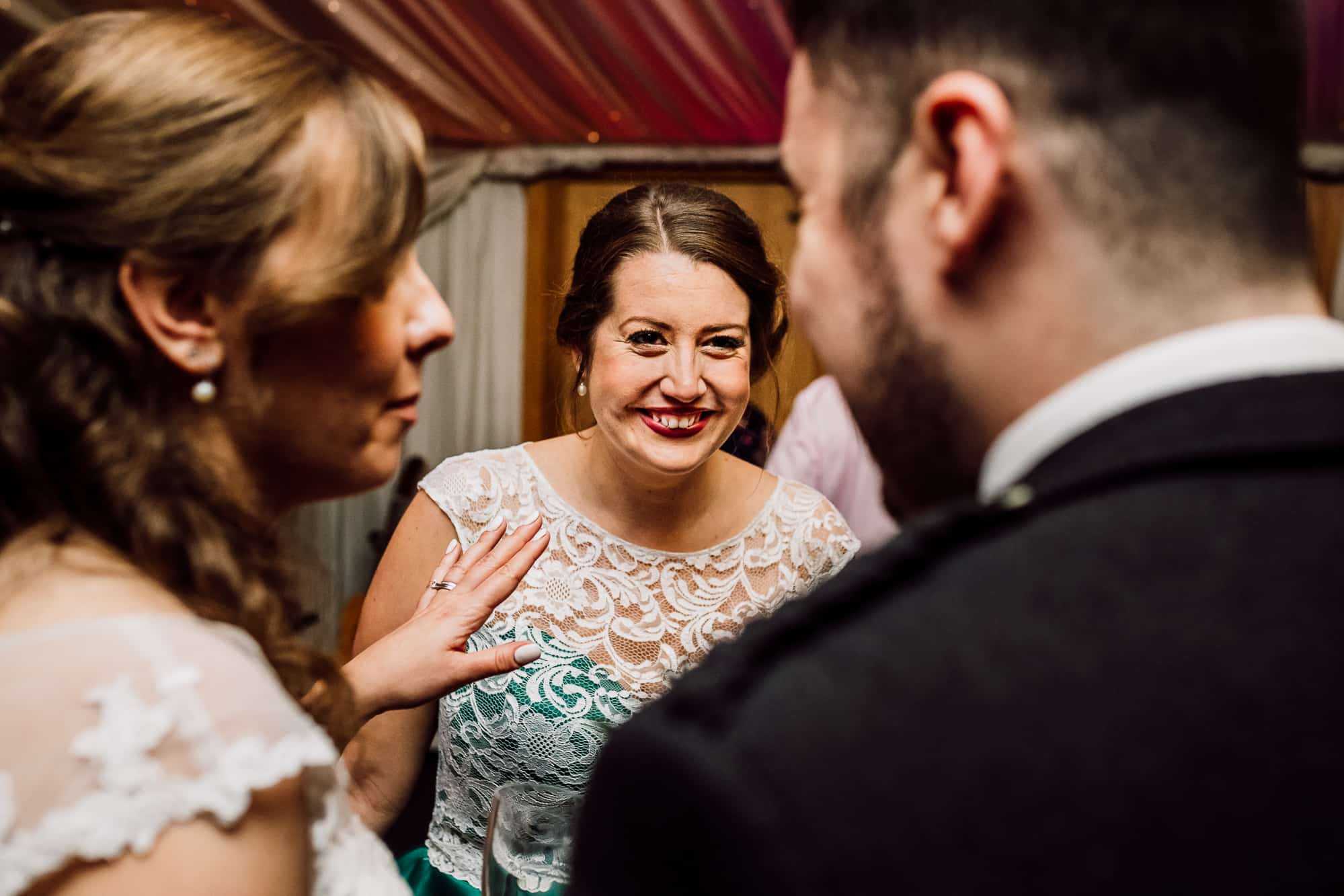 Bridesmaids and guests talking at Heaton House Farm