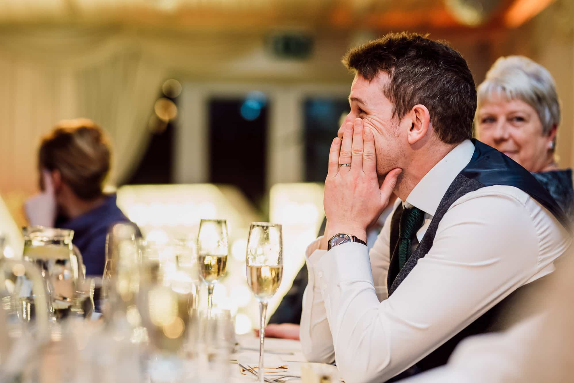 Groom looking shocked during speeches at Heaton House Farm
