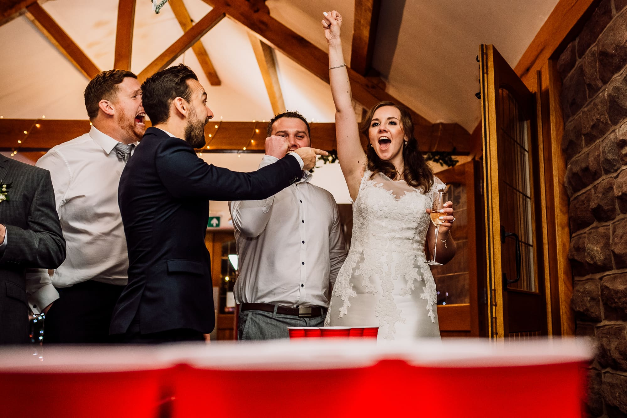 Bride playing beer pong at Heaton House farm