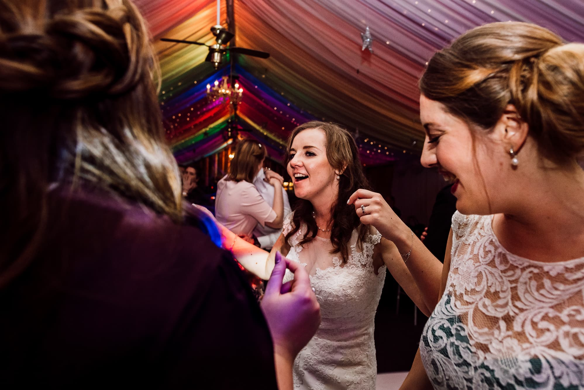 bride dancing with her bridesmaid at Heaton House Farm