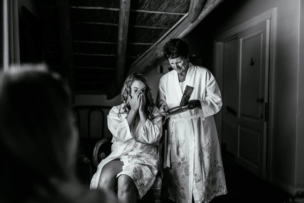 Bride crying with her mum after having her gift