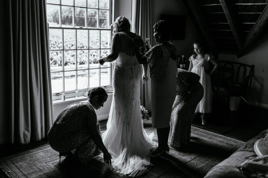 Bride getting dressed at Holden Manz