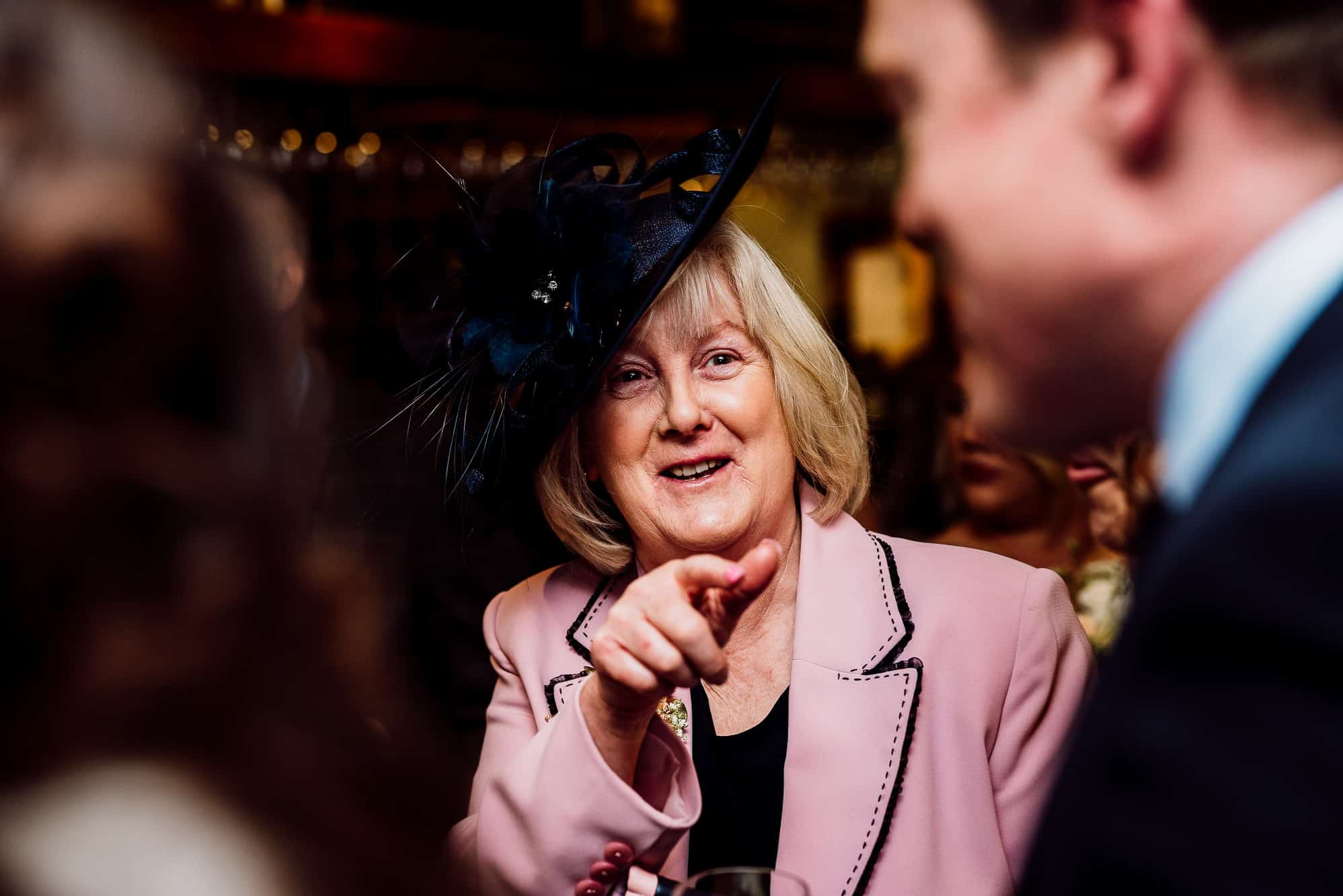 Mother of the bride laughing during reception drinks at the Inn at Whitewell