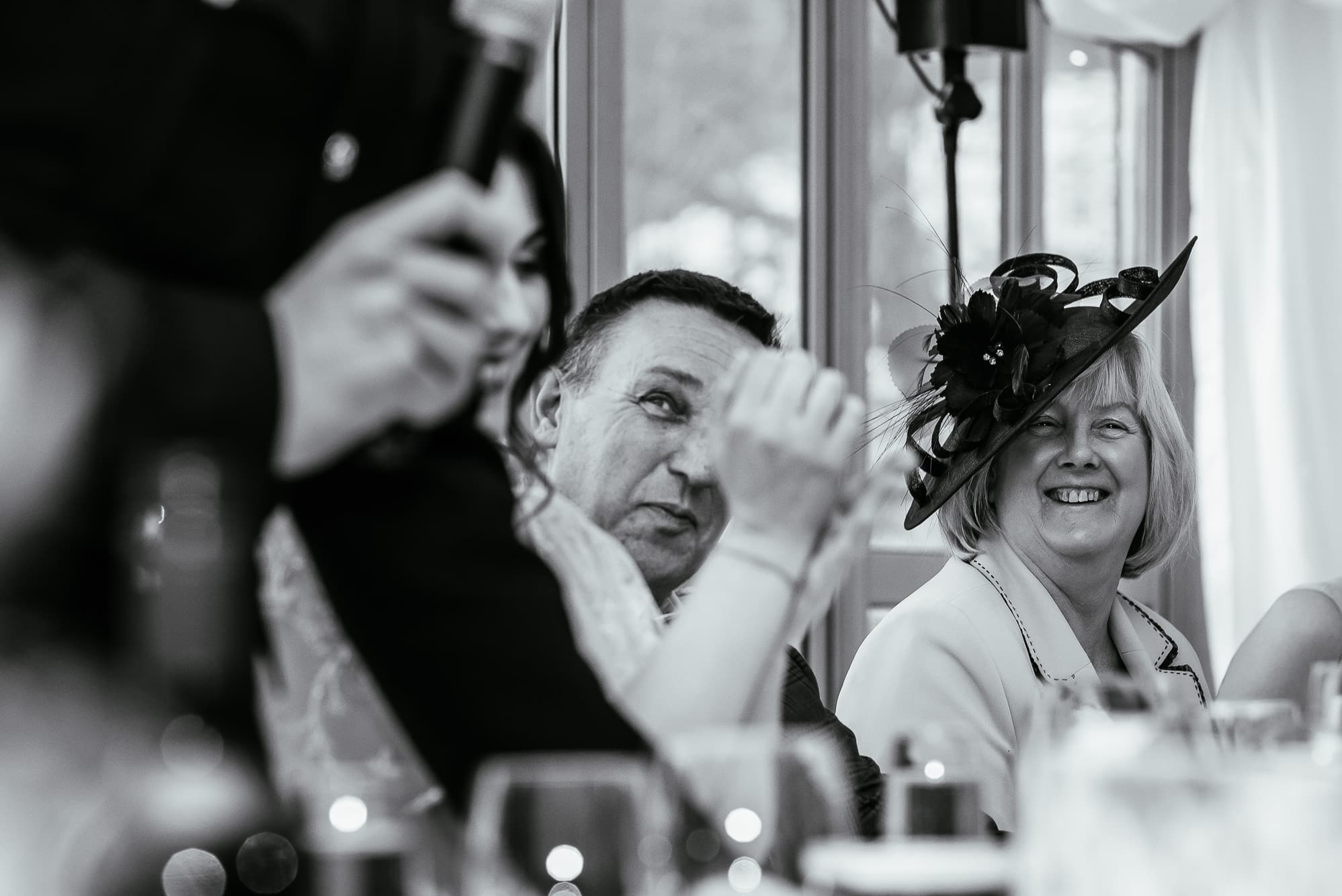 Mother of the bride laughing during speeches