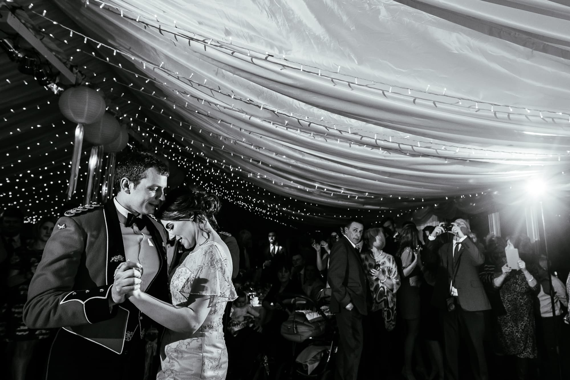 A black and white photo of the bride and groom dancing at the Inn at Whitewell