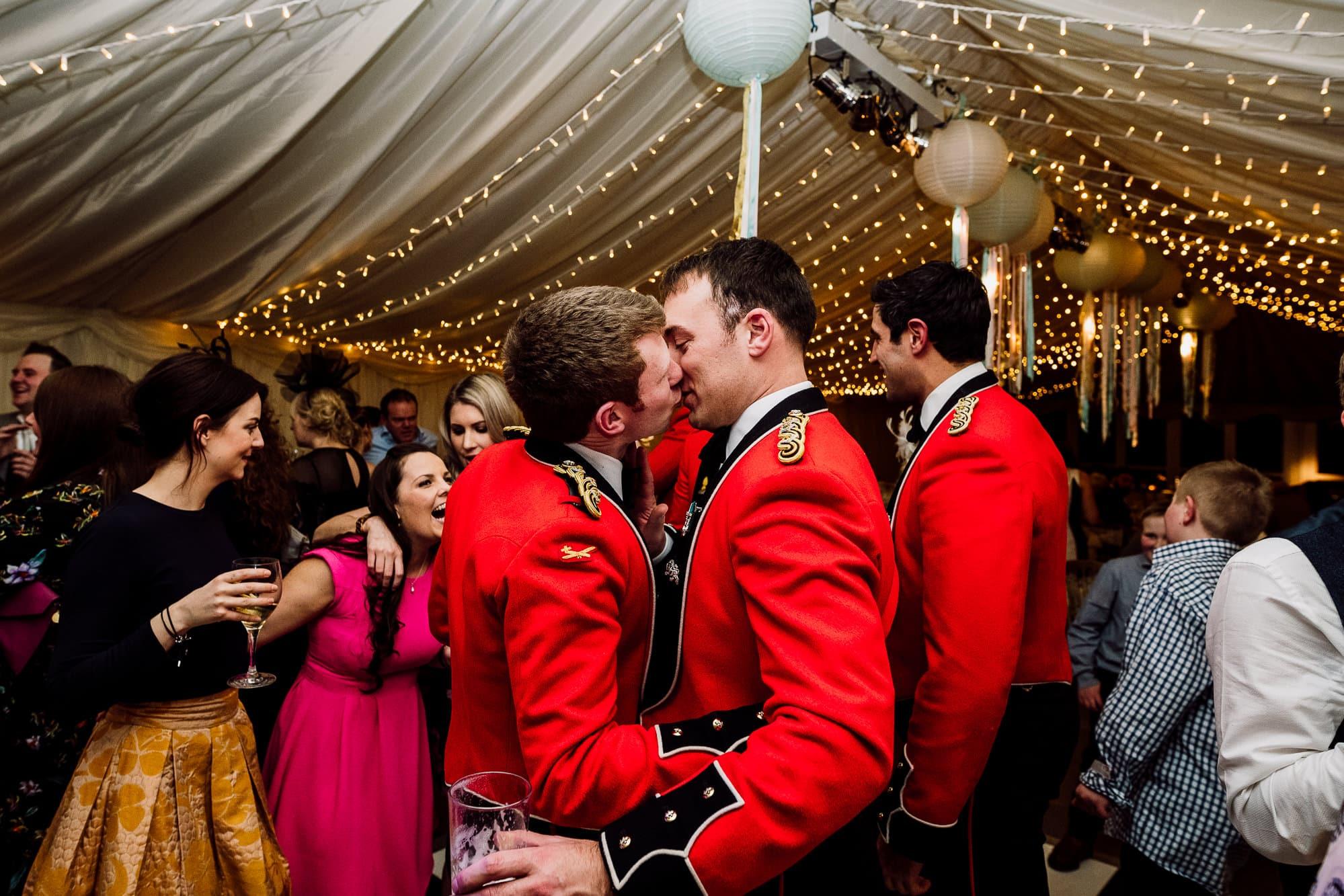 Two men kissing on the dance floor