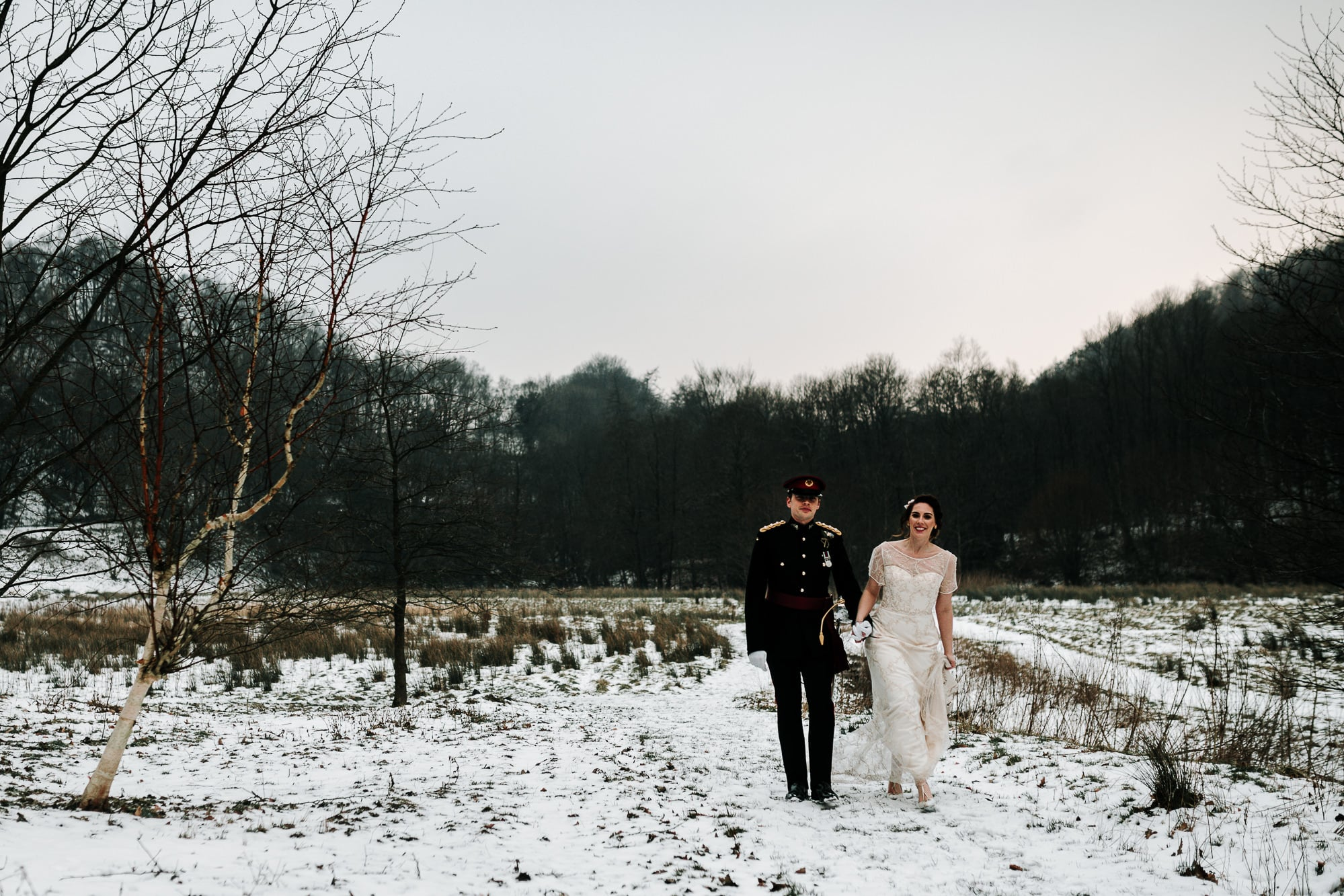 The couple walking in the snow