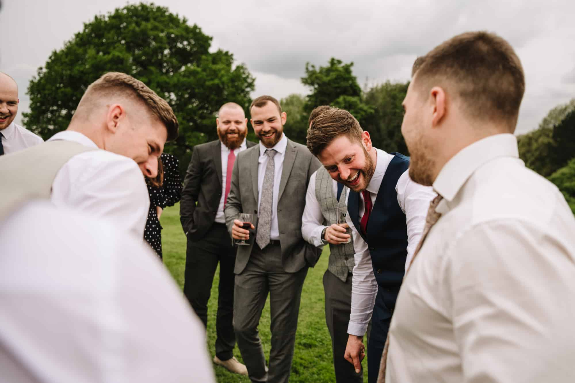 guests laughing in the grounds of Hill Bank Farm