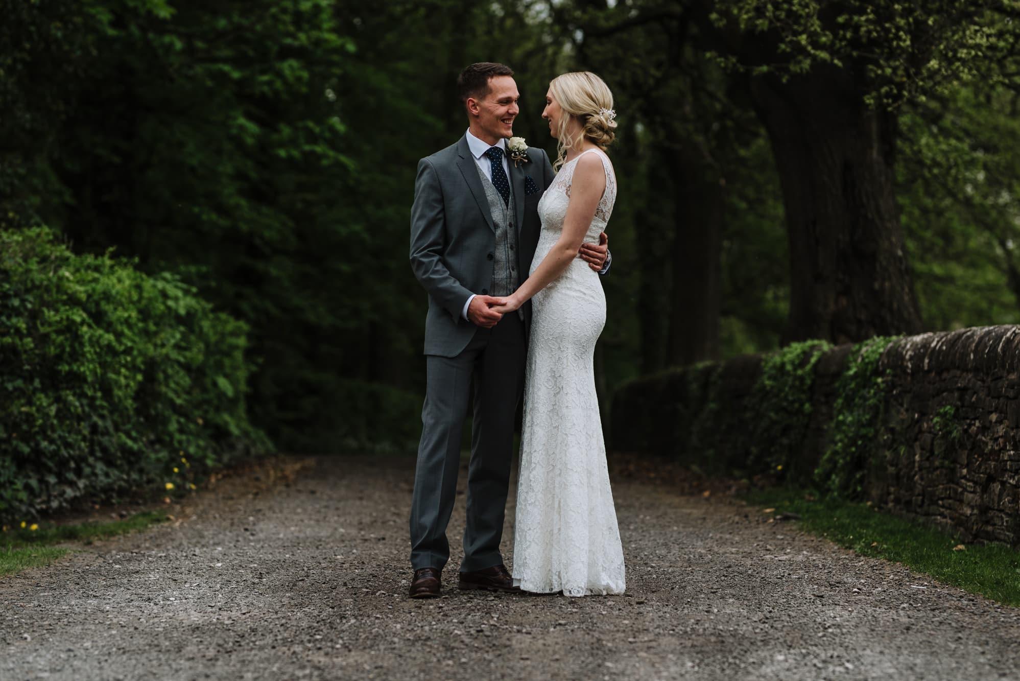 Bride and groom cuddling at Hyde Bank Farm