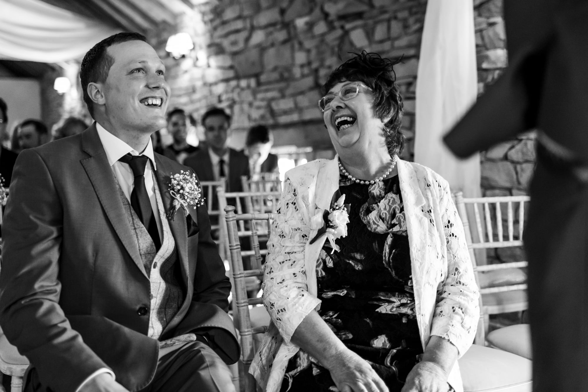 A photo of the mother of the bride laughing