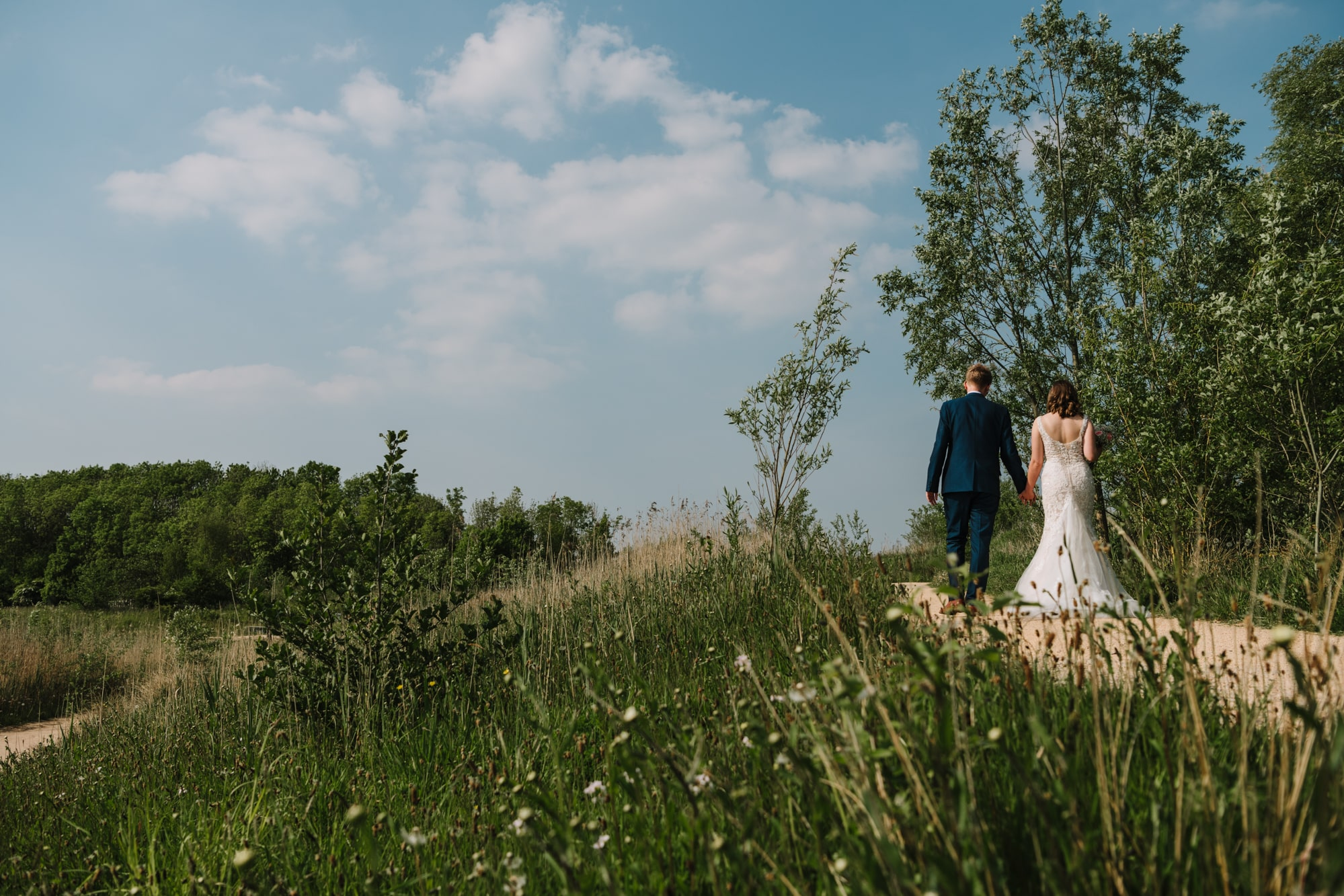 Bride and groom walking at Brockholes