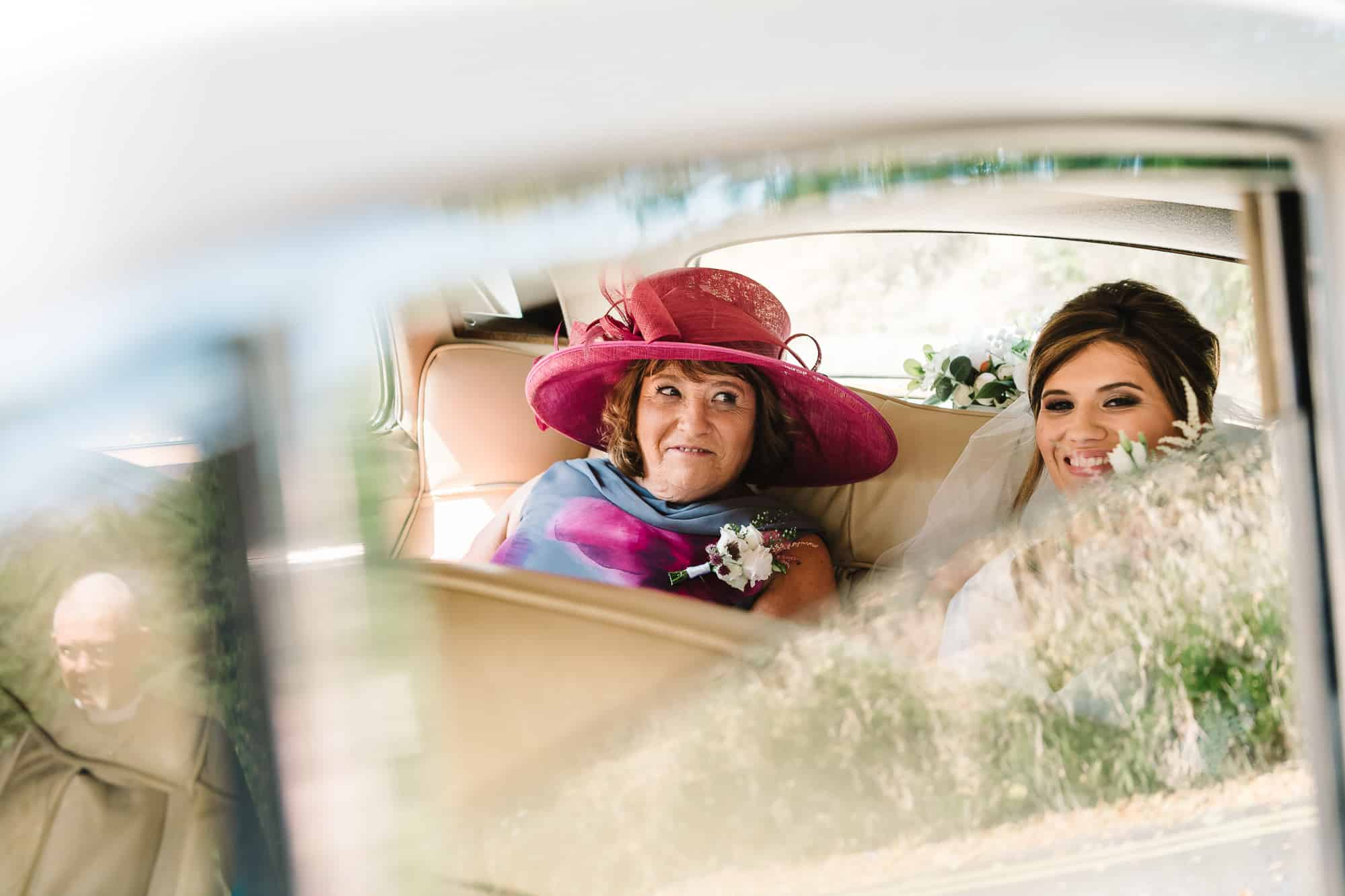Bride with her mum getting out of the campervan