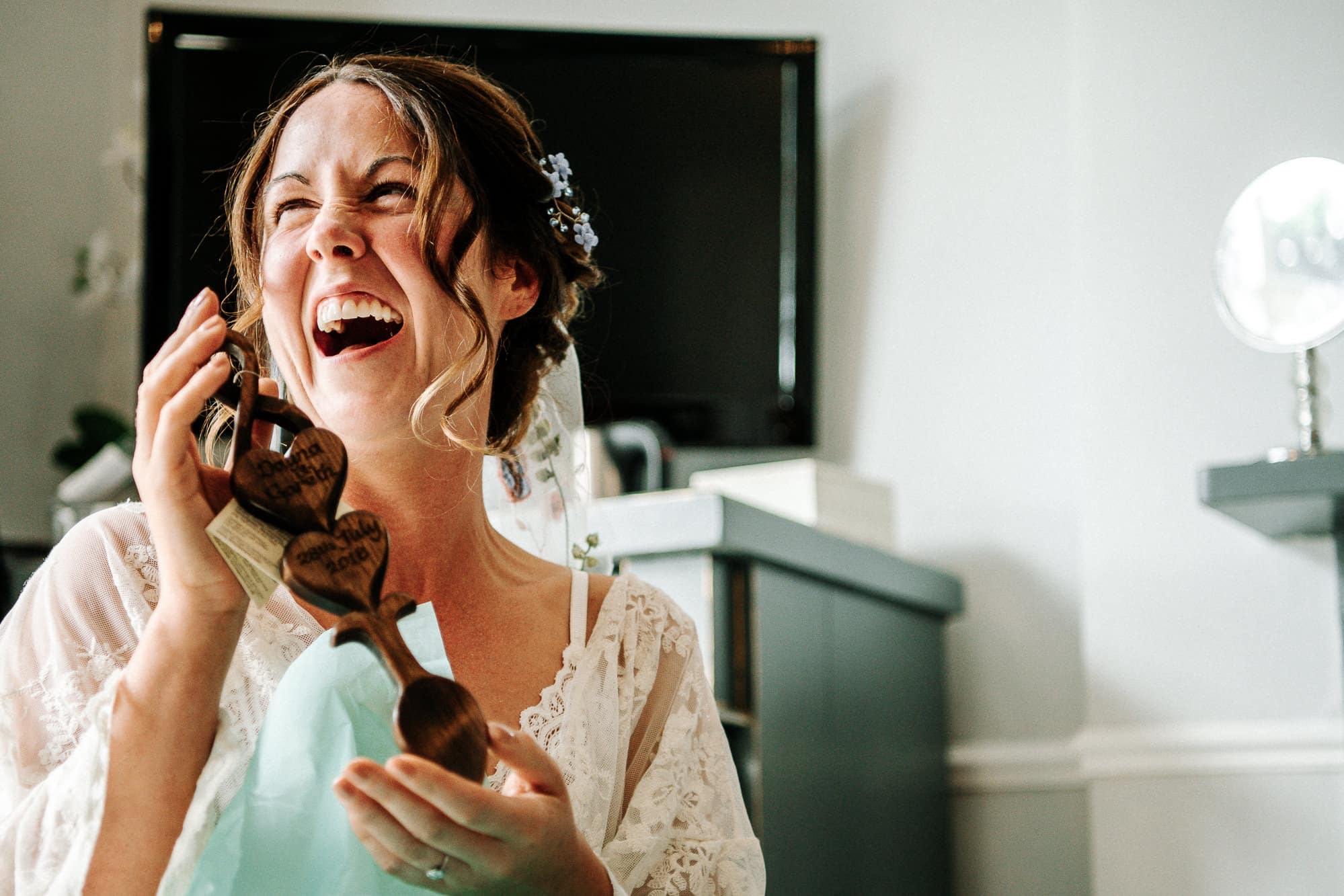 bride laughing at one of her guests