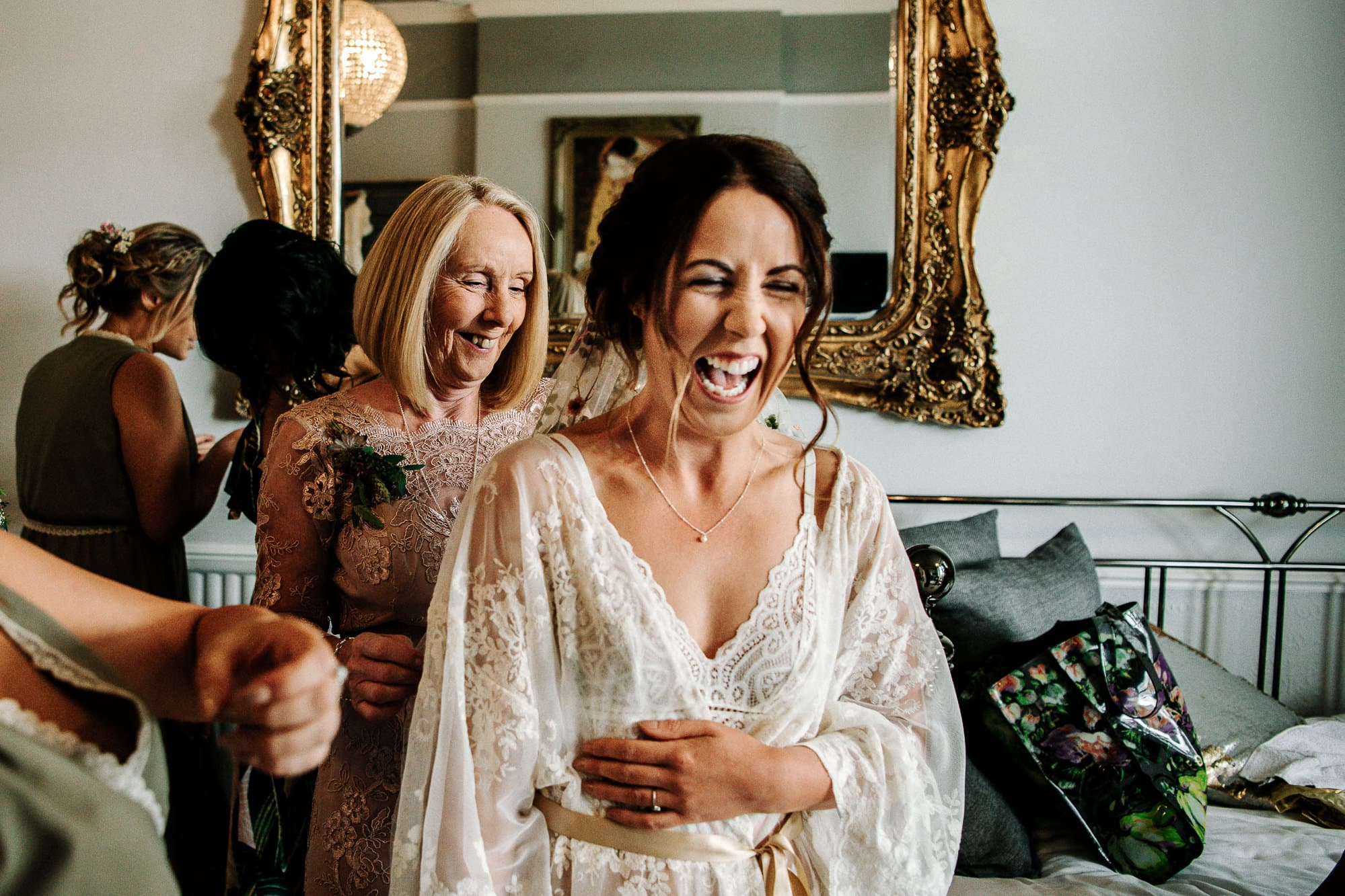 bride laughing during bridal preparation