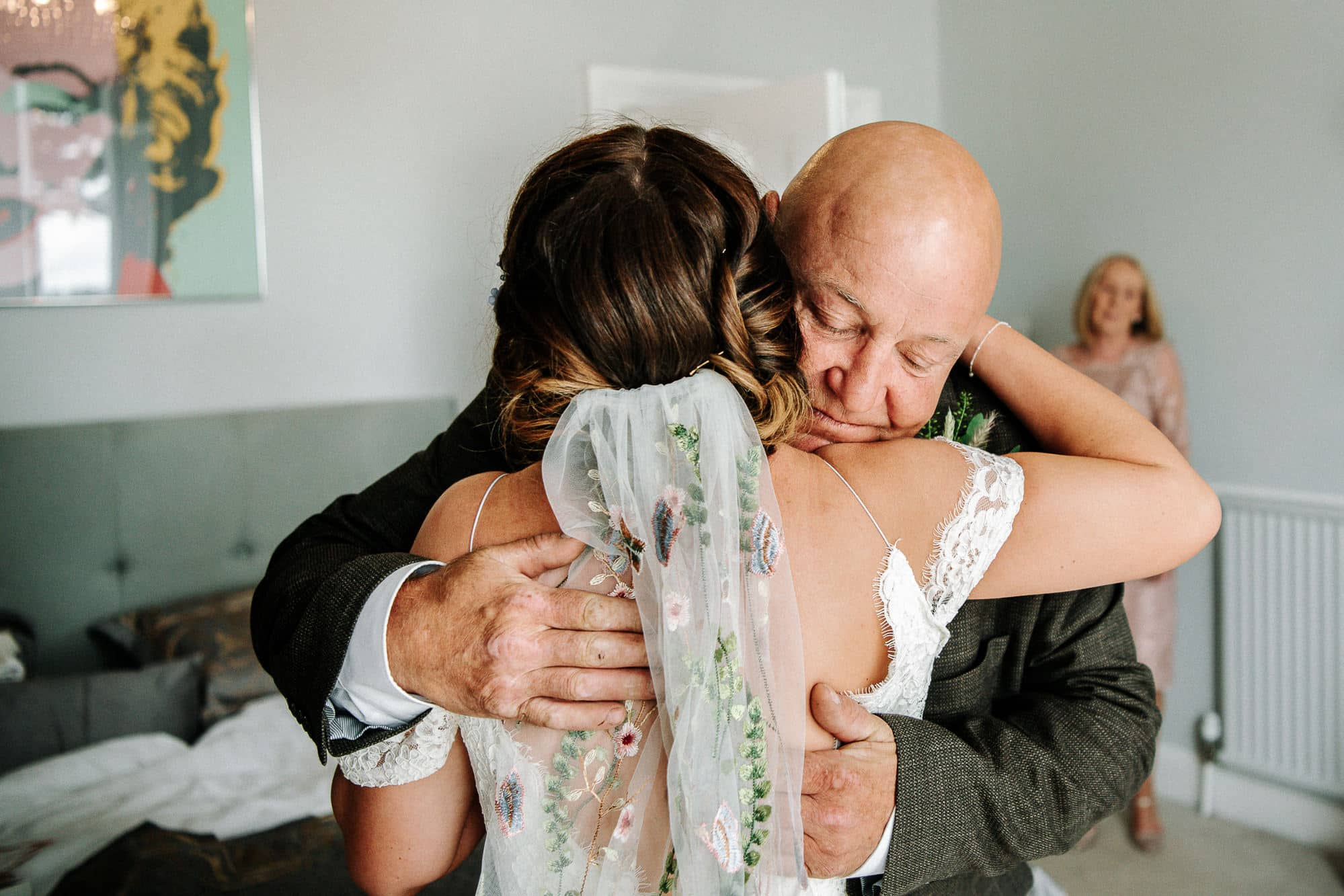 bride and dad hug after seeing each other for the first time