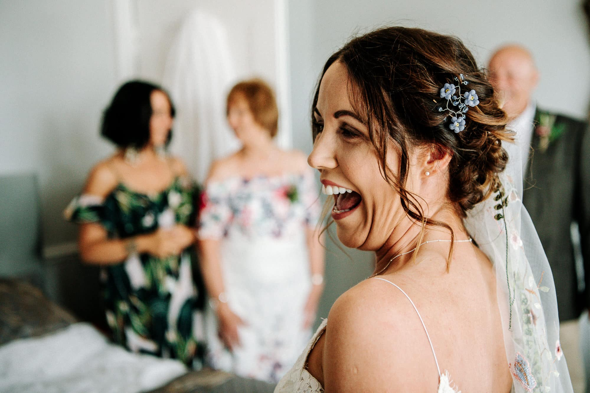 Bride laughing after seeing her dad