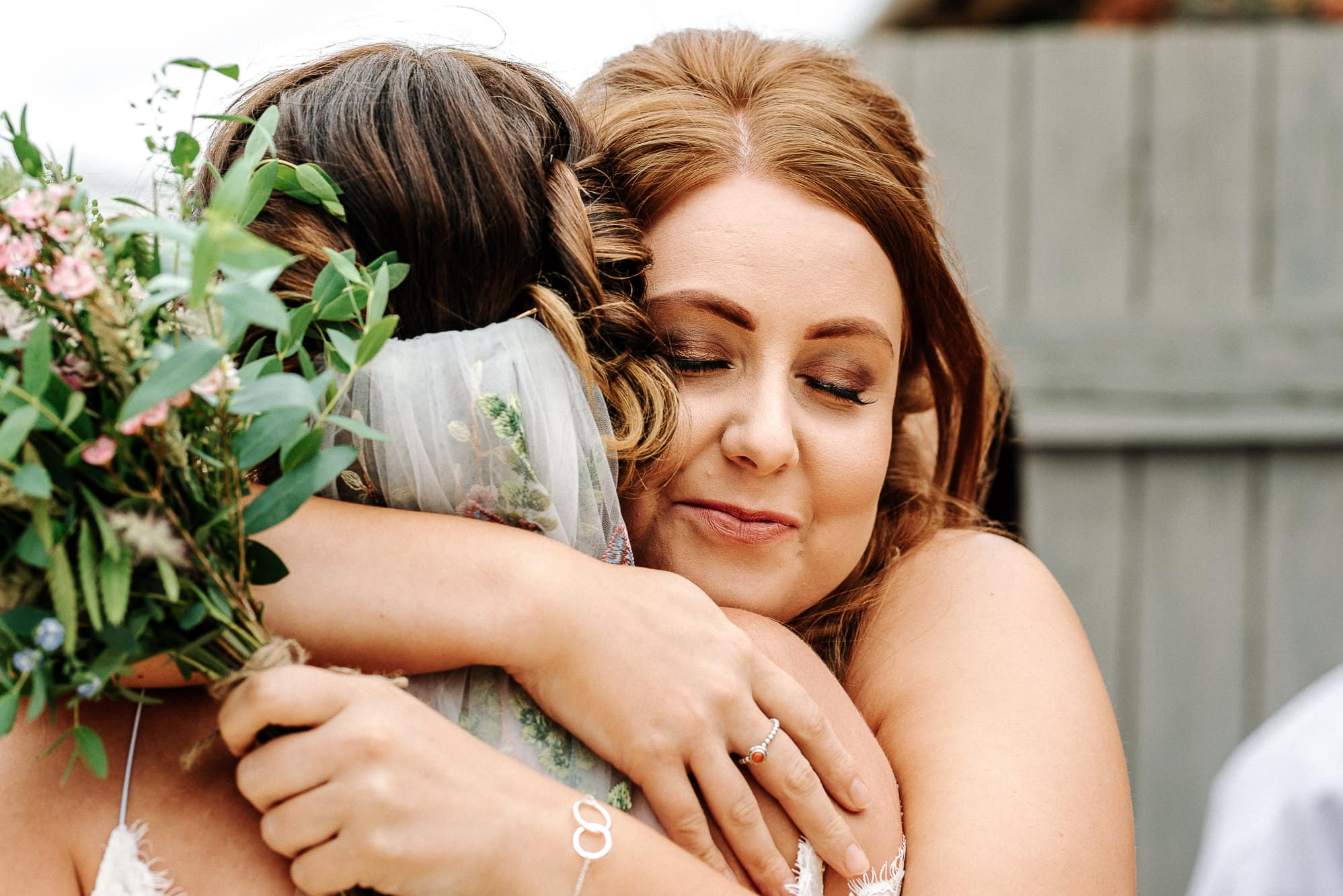 bride hugging her sister at Stanford farm