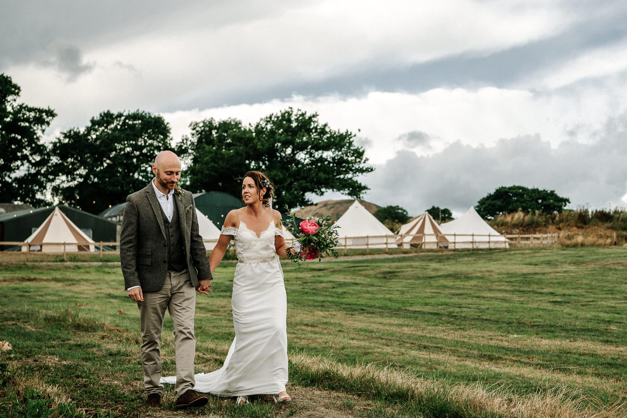 bride and groom walking at Stanford farm
