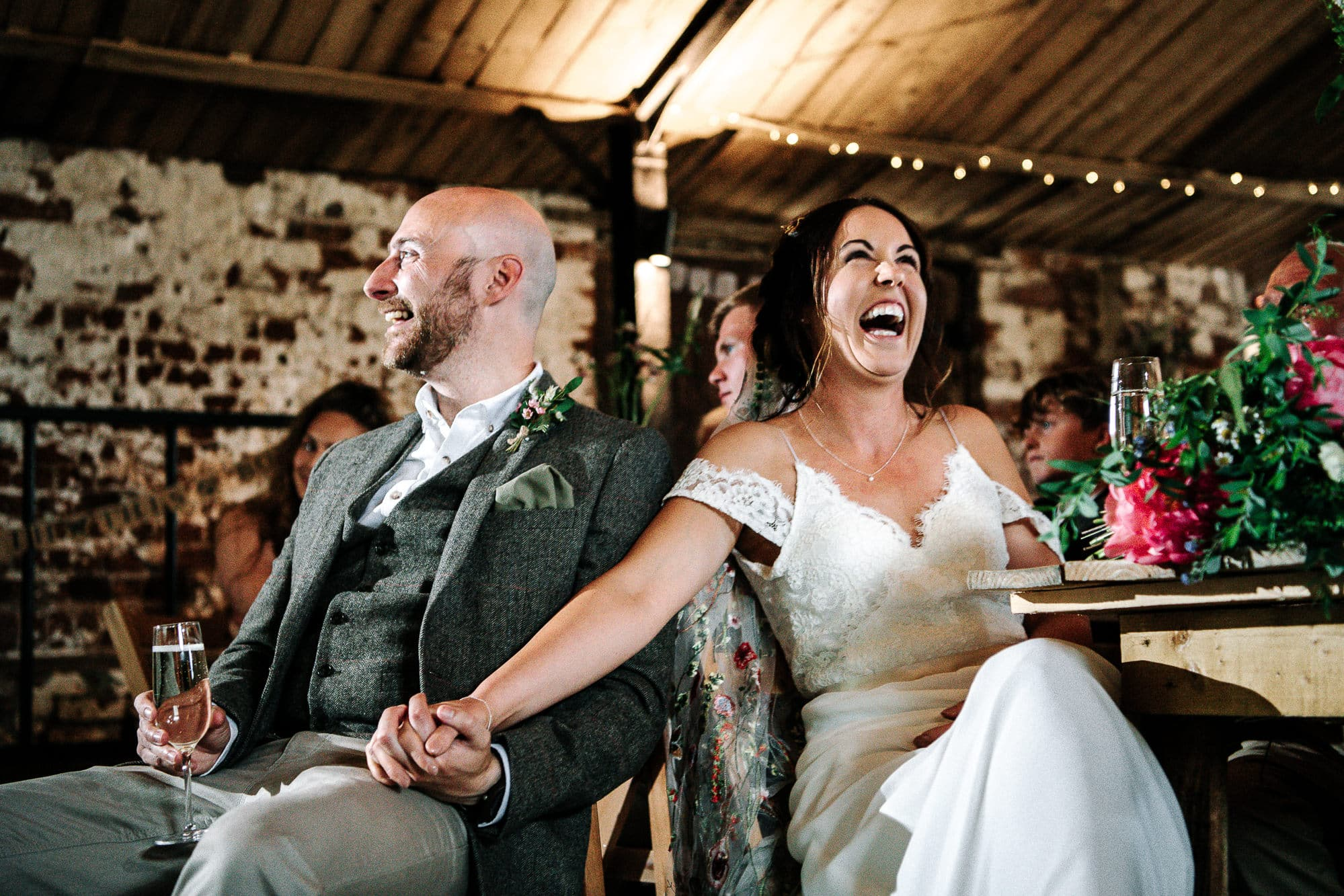 bride and groom laughing during speeches at stanford farm
