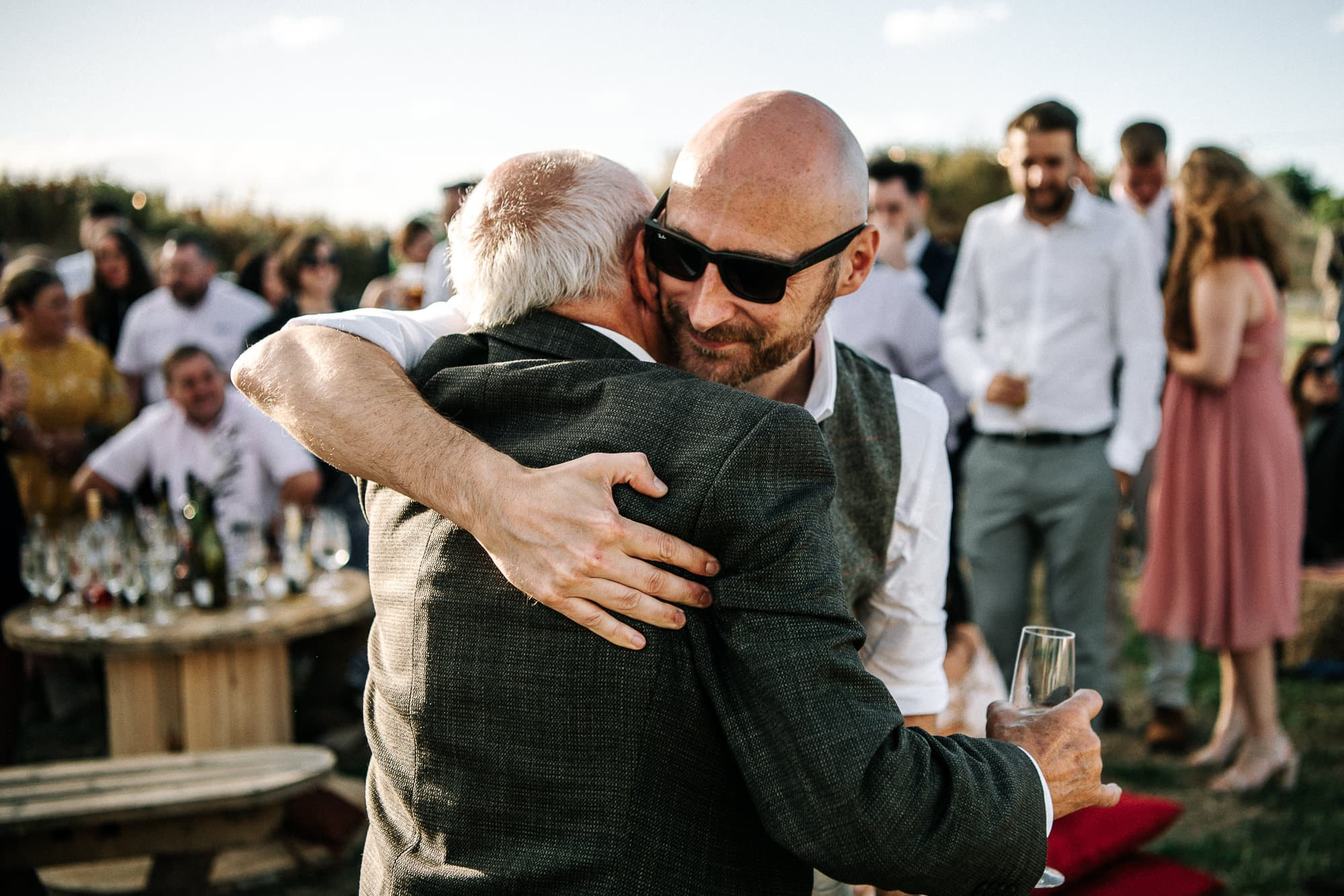 groom hugging his dad at Stanford farm