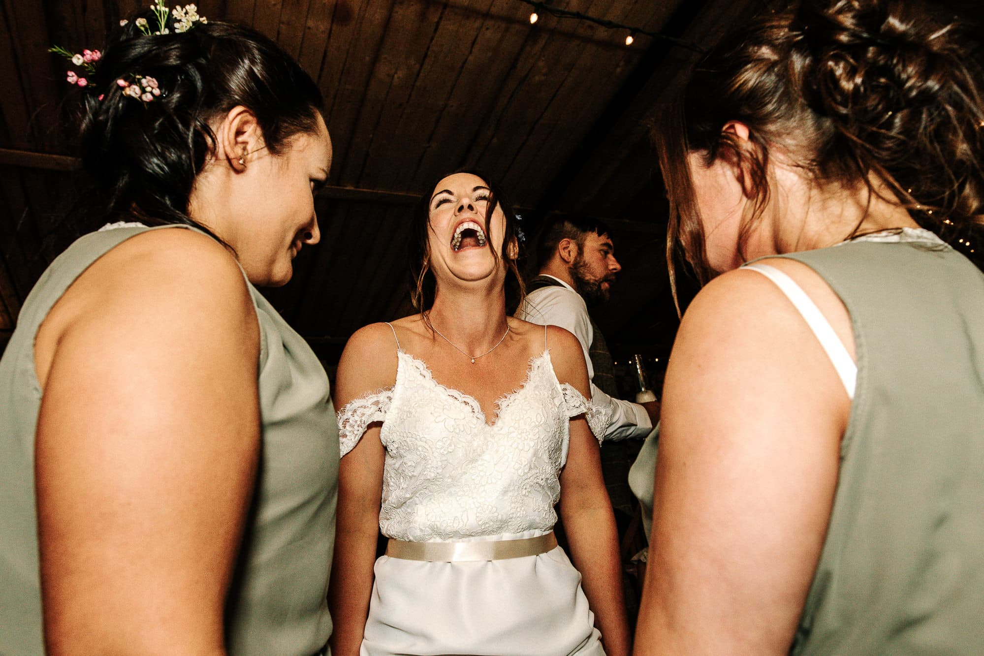 bridesmaid and her bridesmaids dancing at standard farm