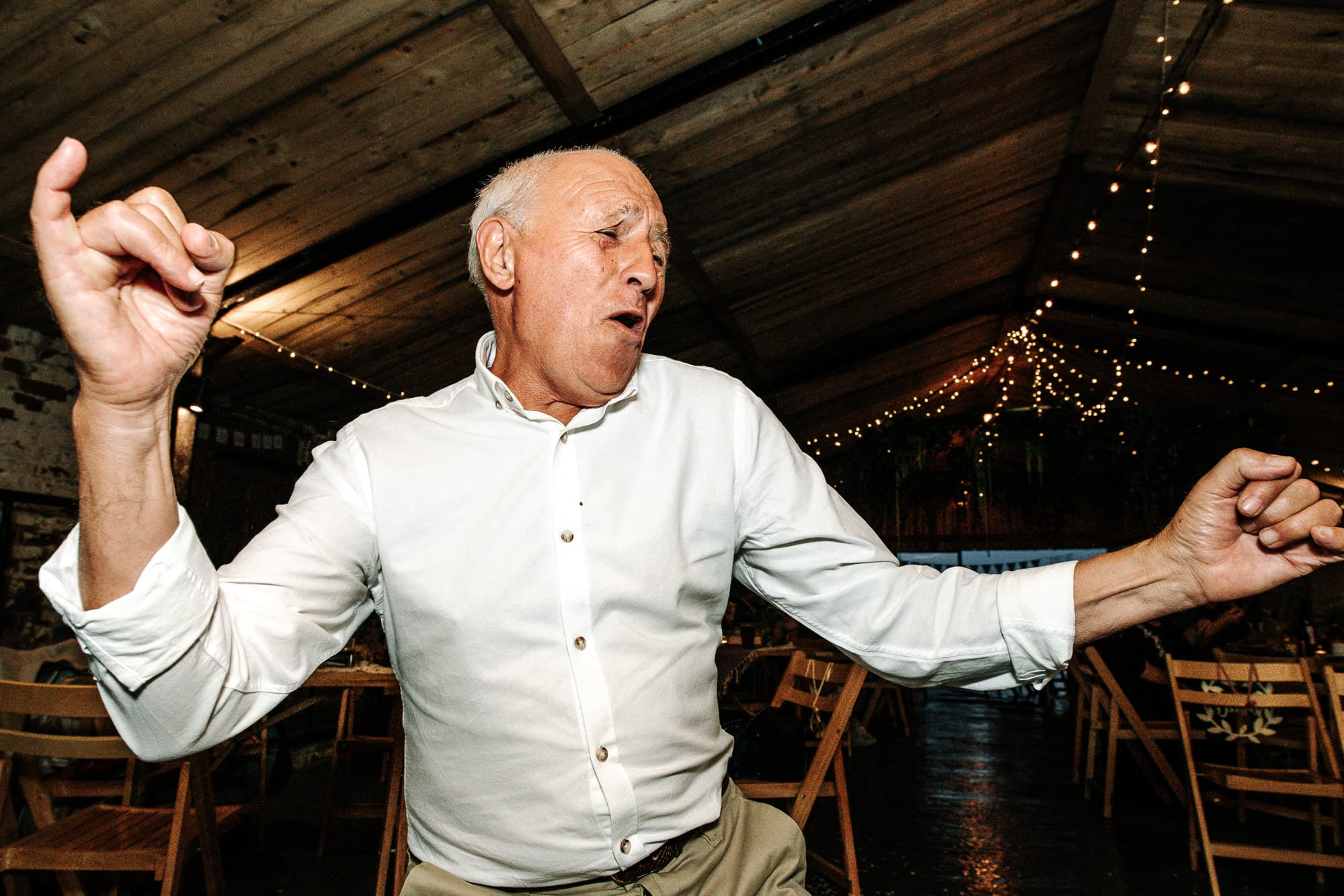 father of the groom dancing at Stanford farm