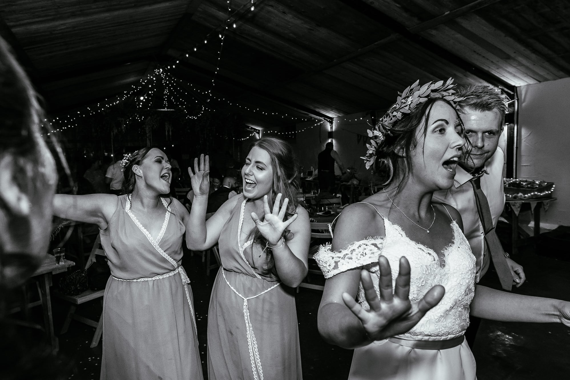 bride and her bridesmaids dancing at Stanford farm