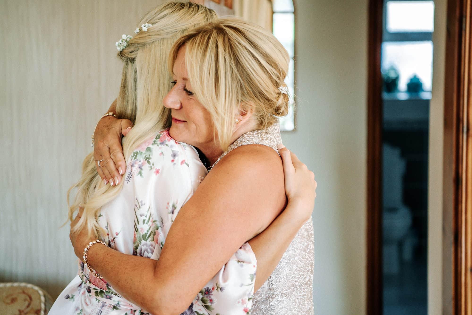 Mum hugging the bridesmaid