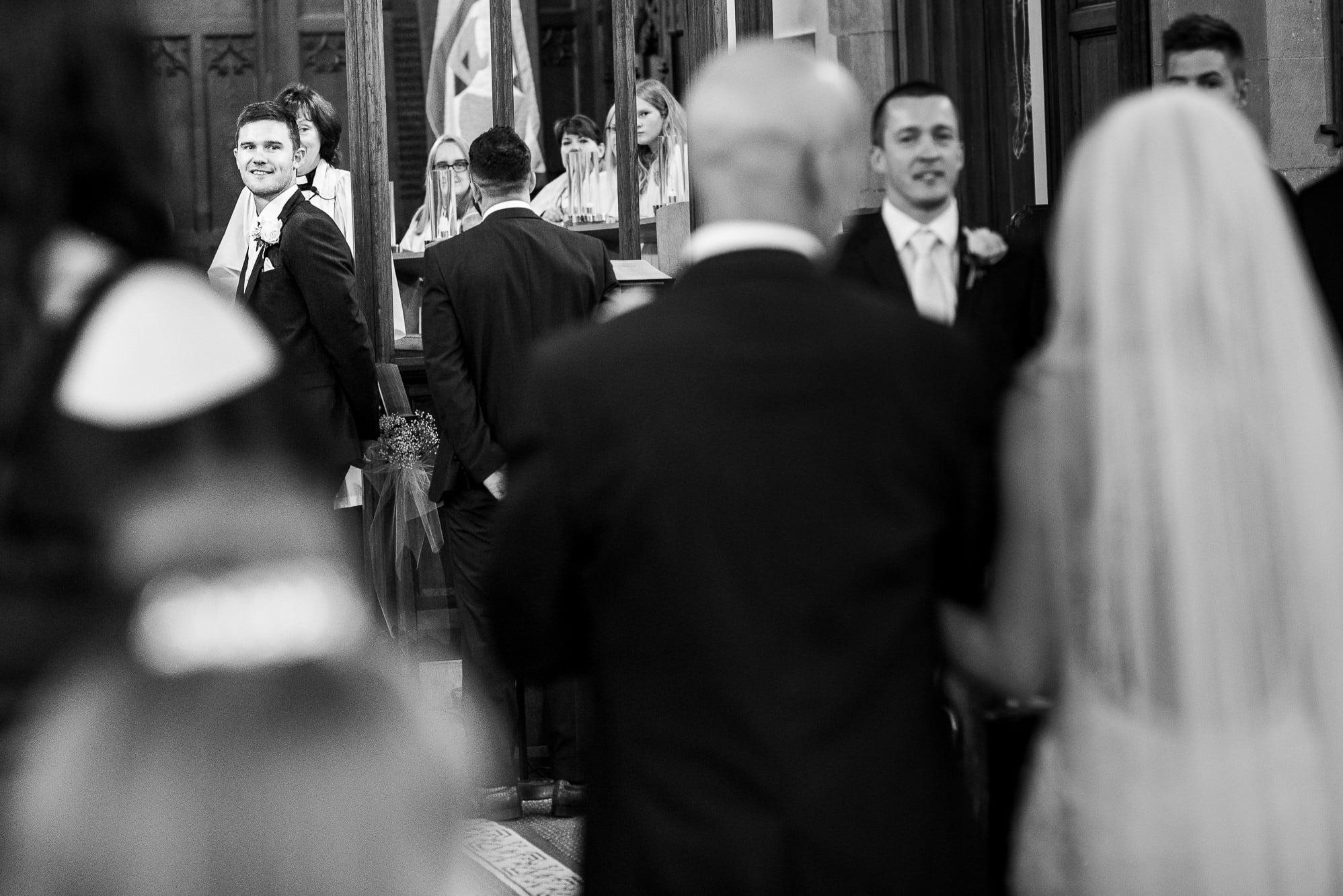 Groom looking back at his bride