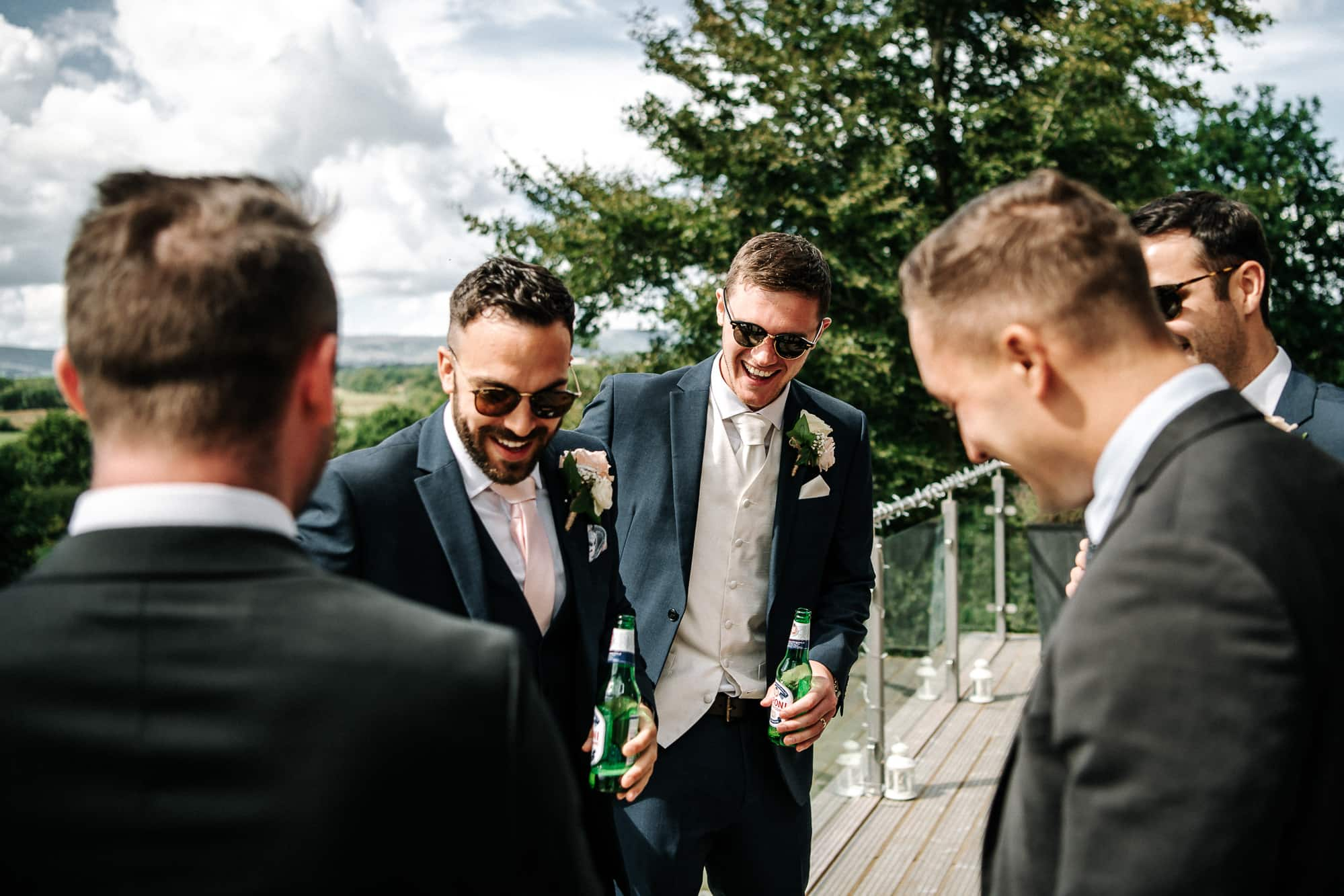 Guests laughing during reception drinks