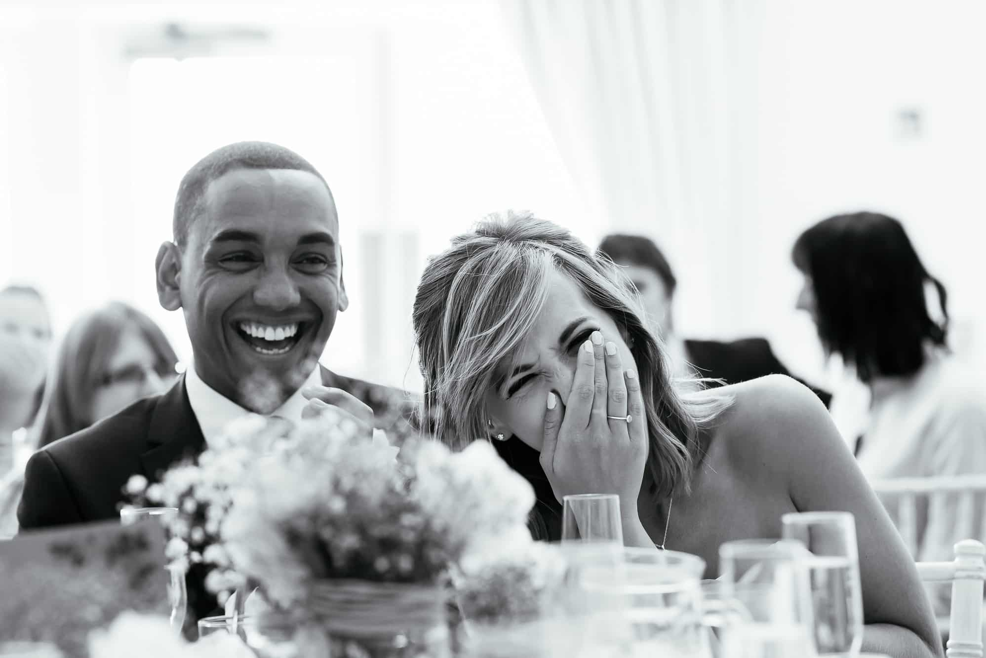 Guests laughing during speeches