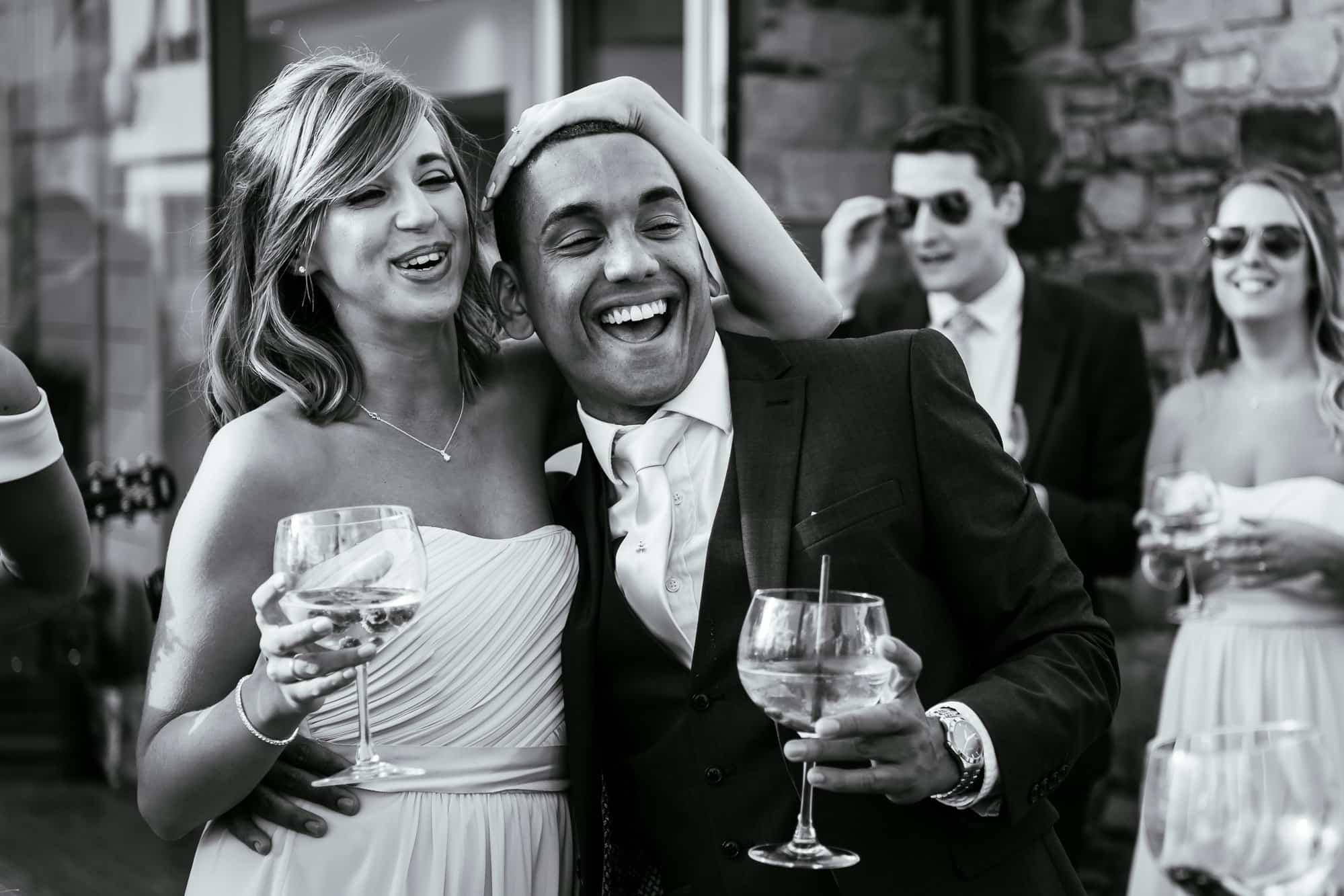 Bridesmaid and usher dancing