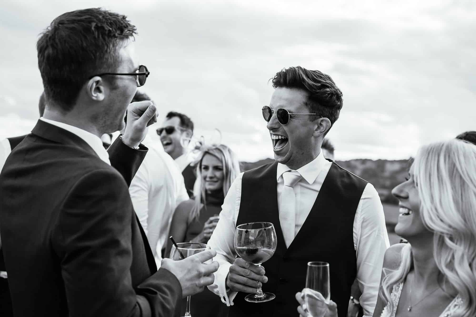 Guests laughing with the groom