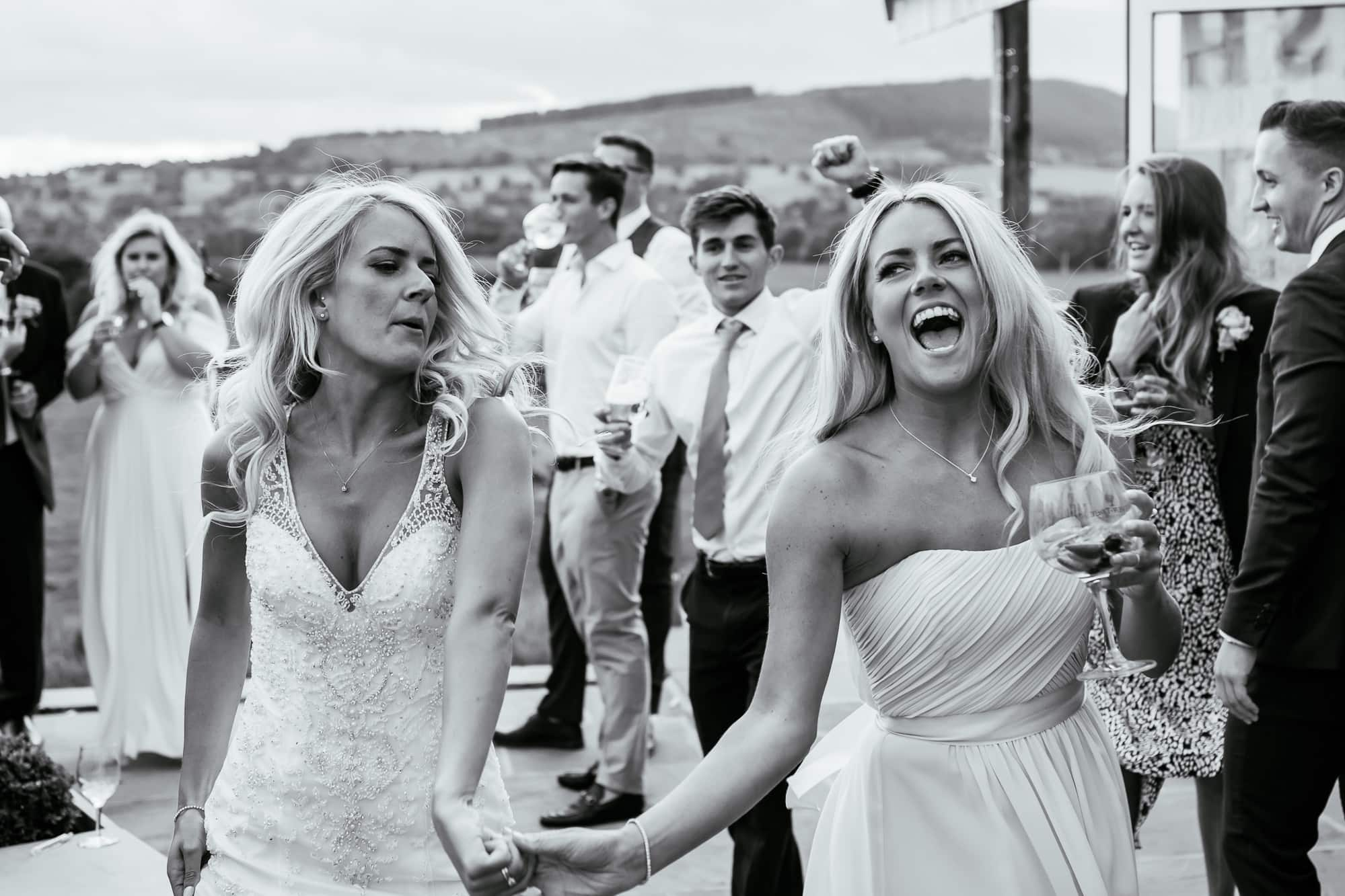 Bride and her sister dancing at Bashall Barn