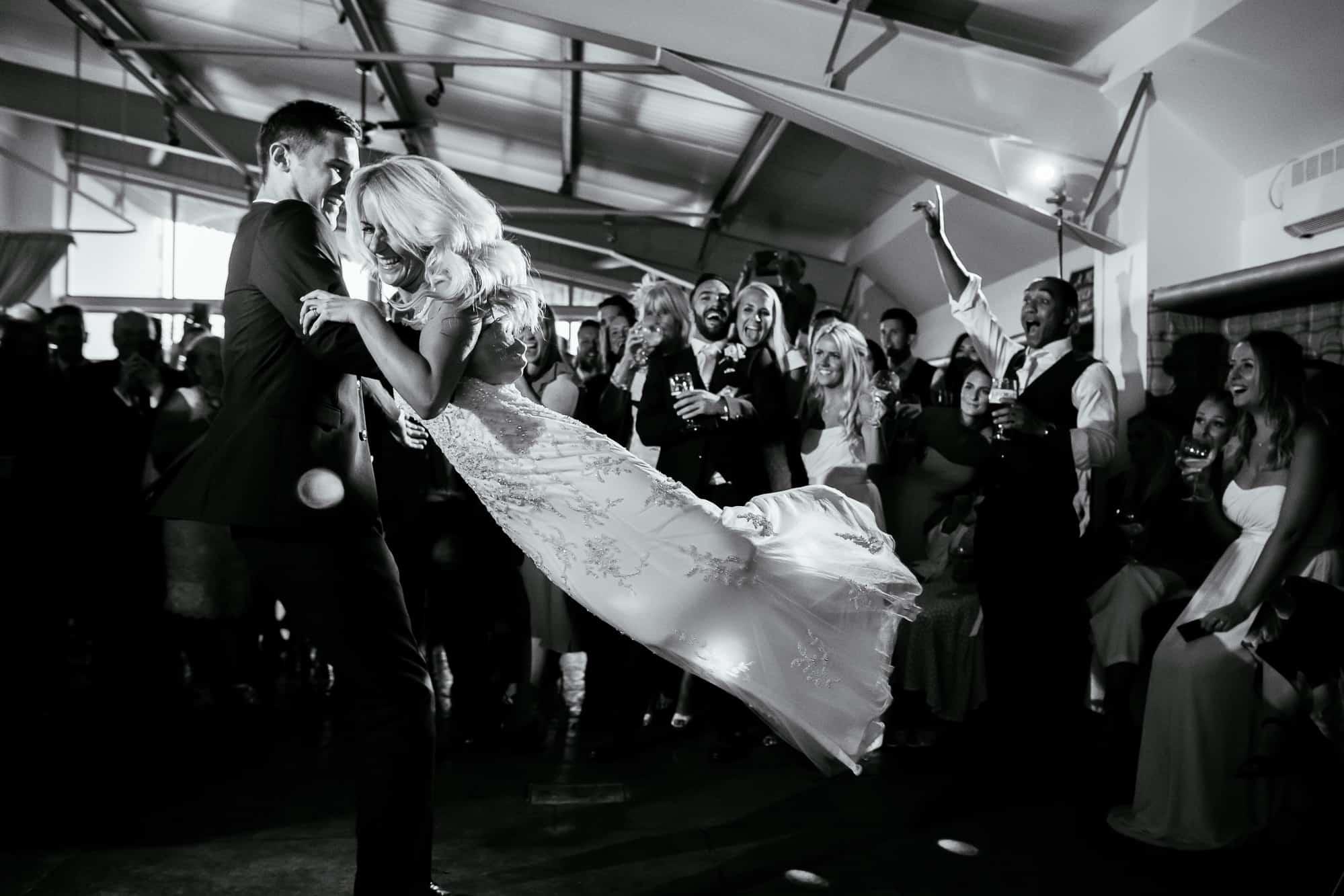bride being spun round during first dance