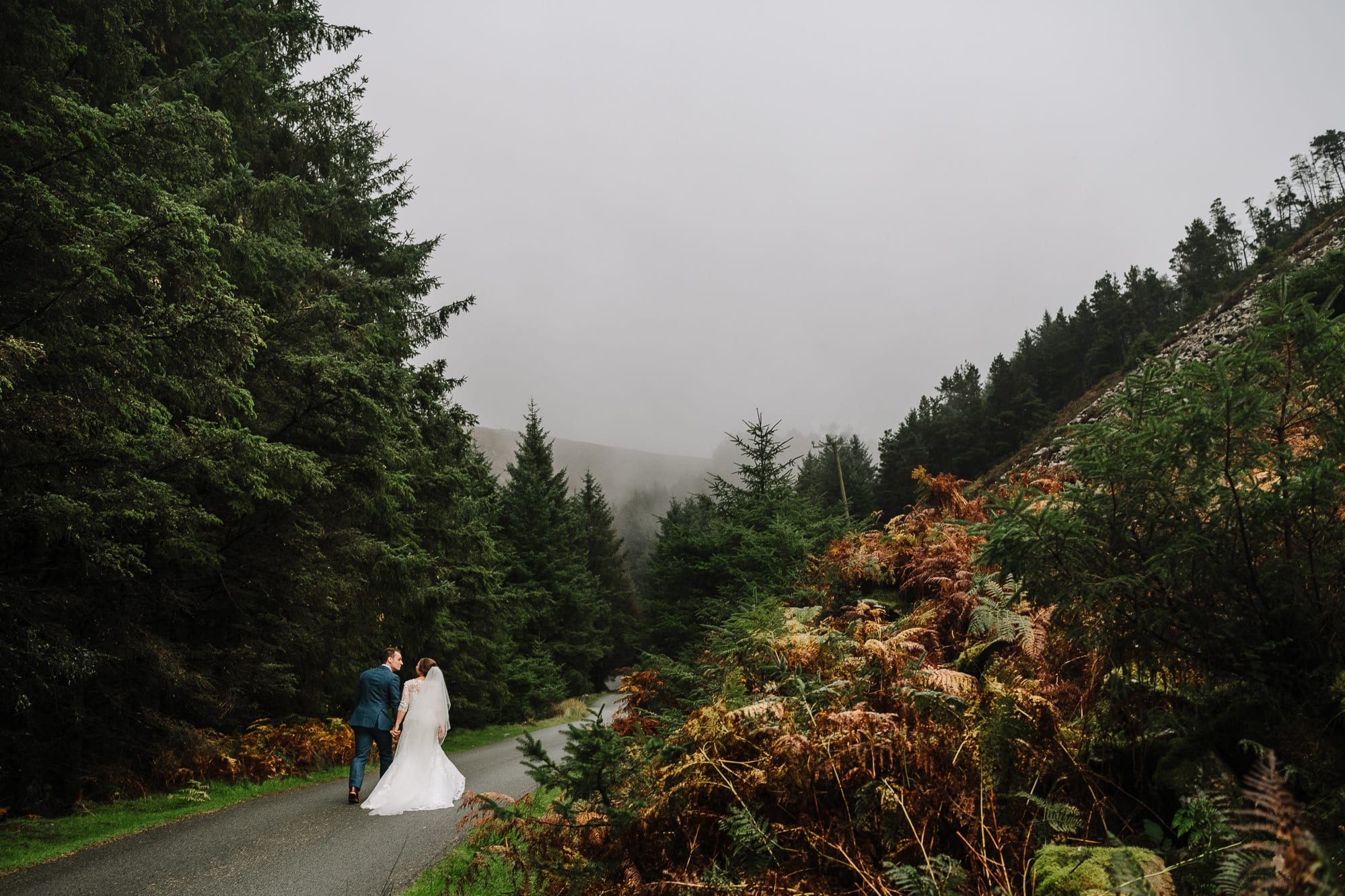 bride and groom walking in Nant Gwrtheyrn