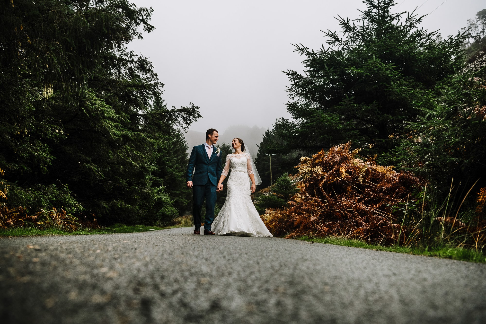 photo of the bride and groom on the road in Nant Gwrtheyrn