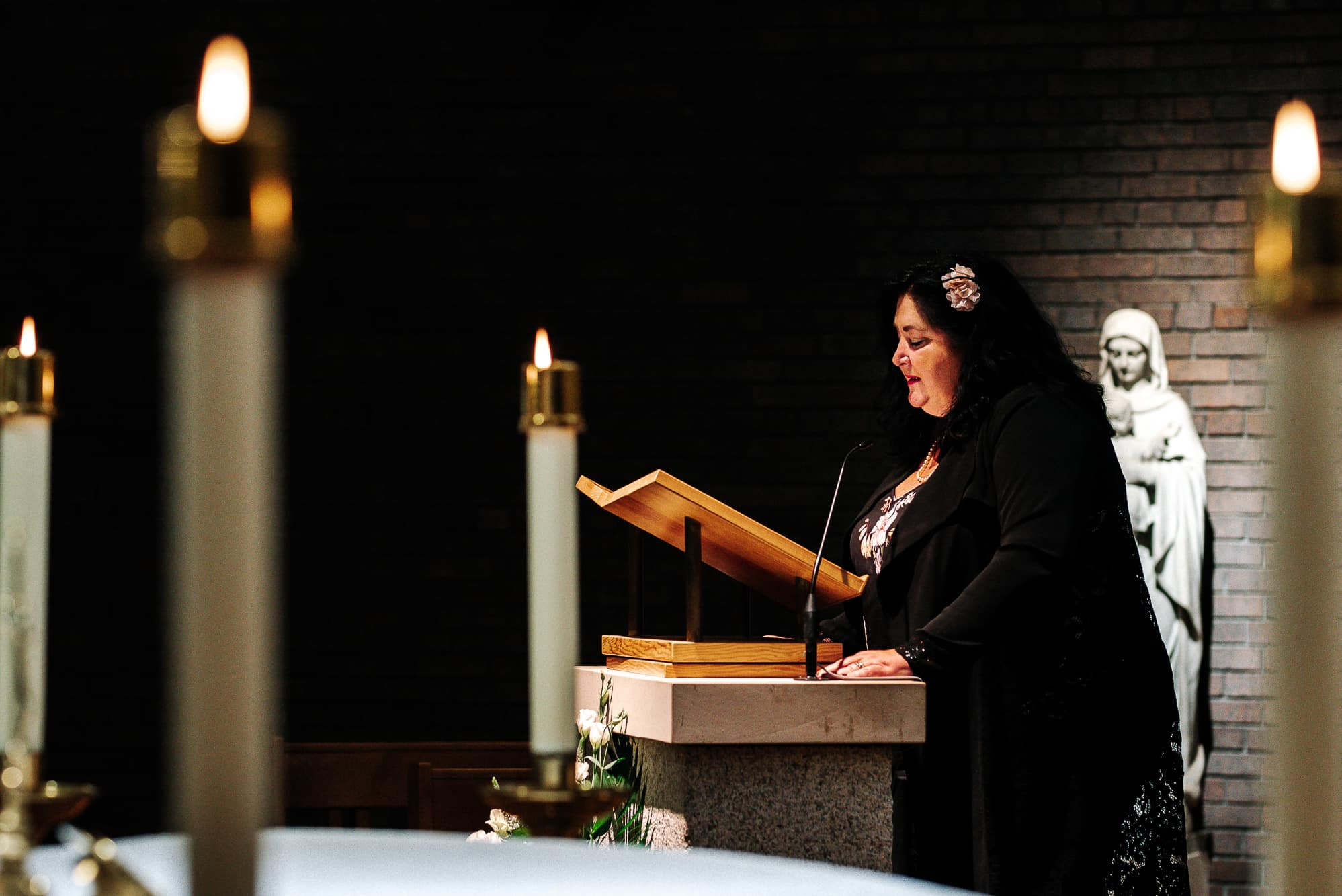 female guest giving a reading during service