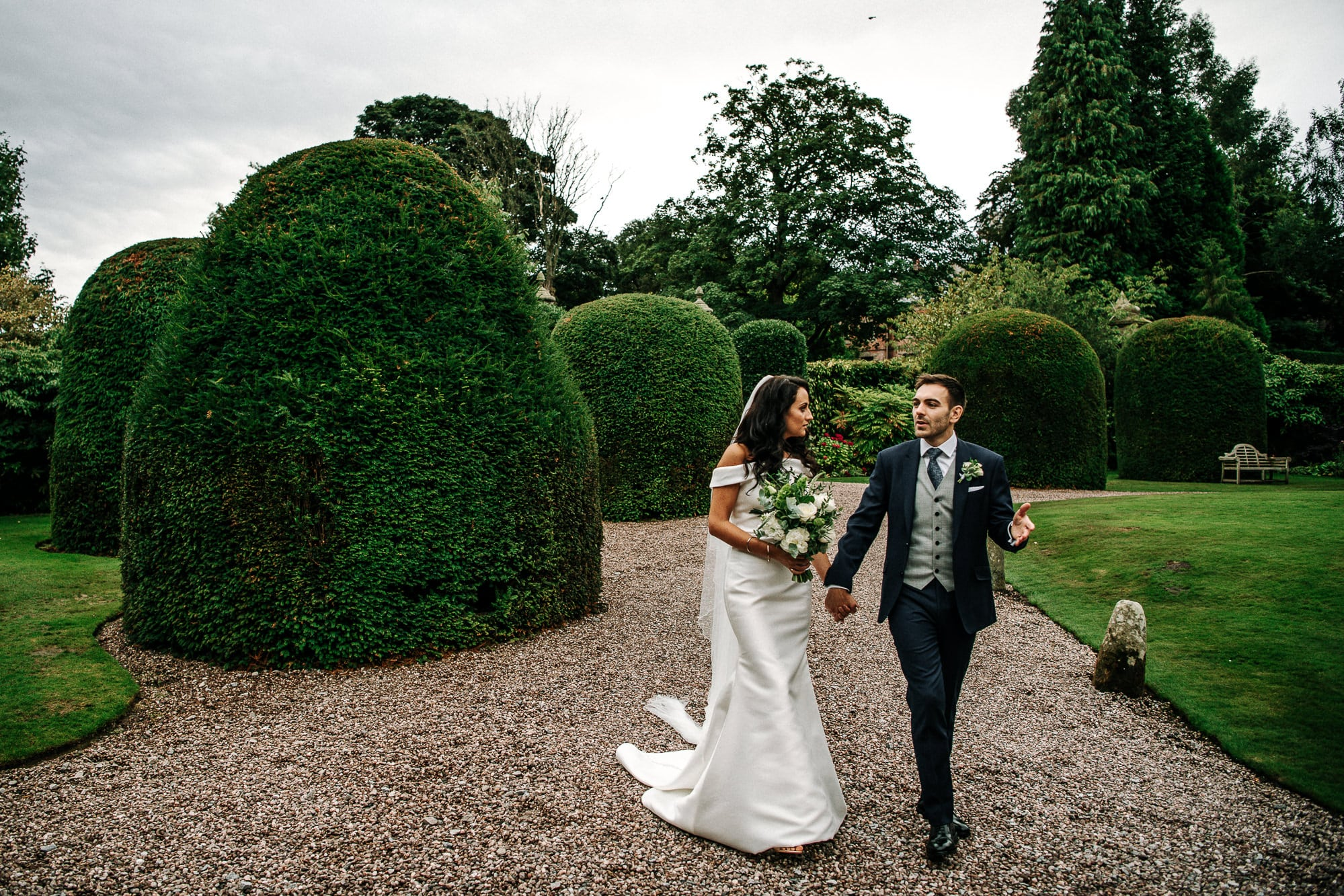 bride and groom walking at Soughton Hall