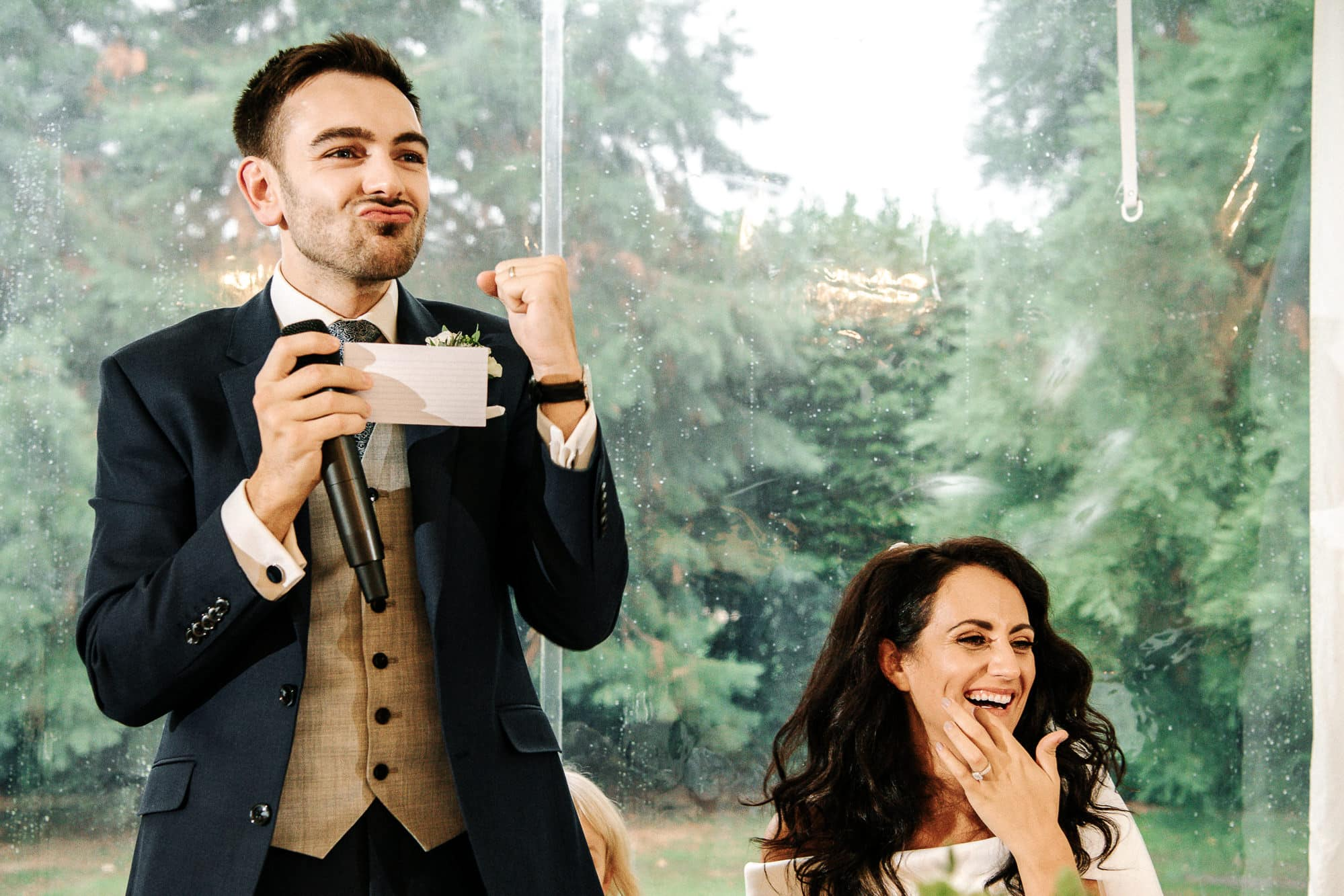 bride laughing and groom laughing
