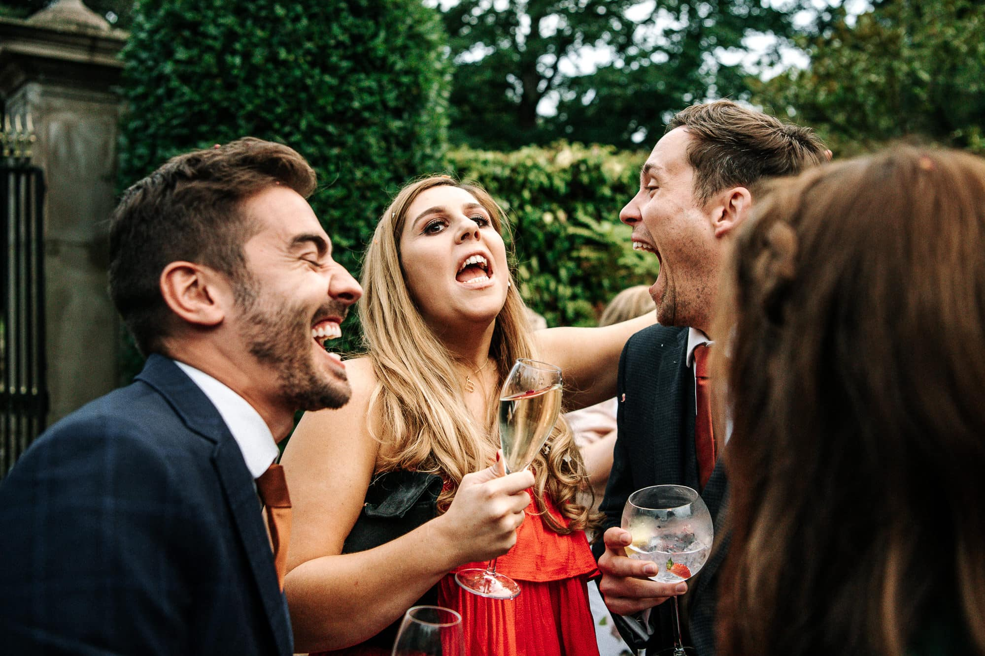 Guests laughing outside at Soughton Hall