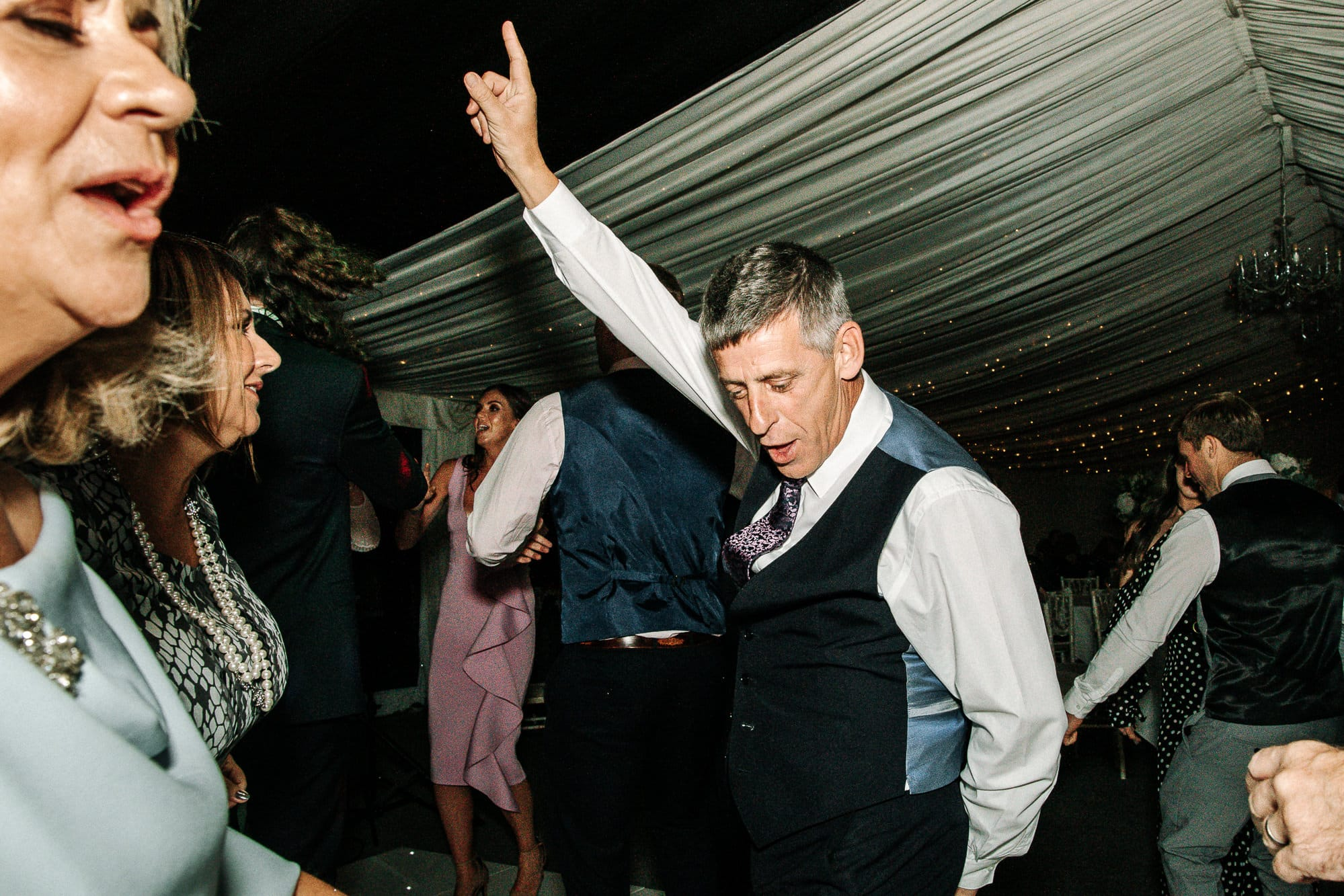 guest dancing with his arm in the air