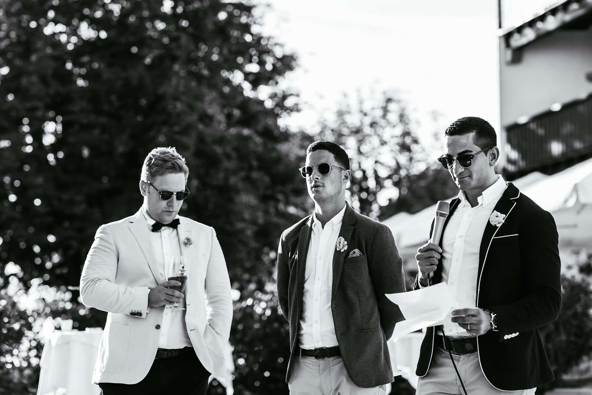 Three groomsmen outside the Seehotel on Lake Constance