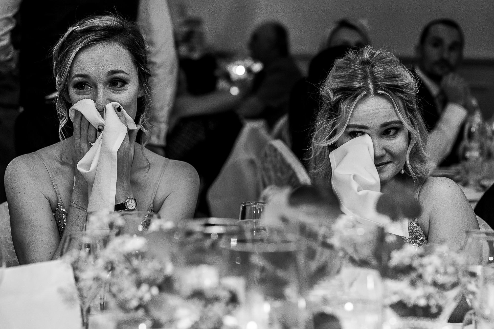 Two bridesmaid crying