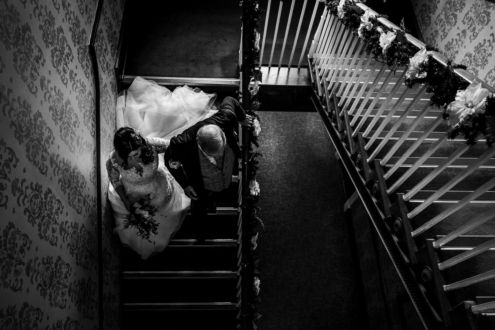 Bride and her dad walking down stairs
