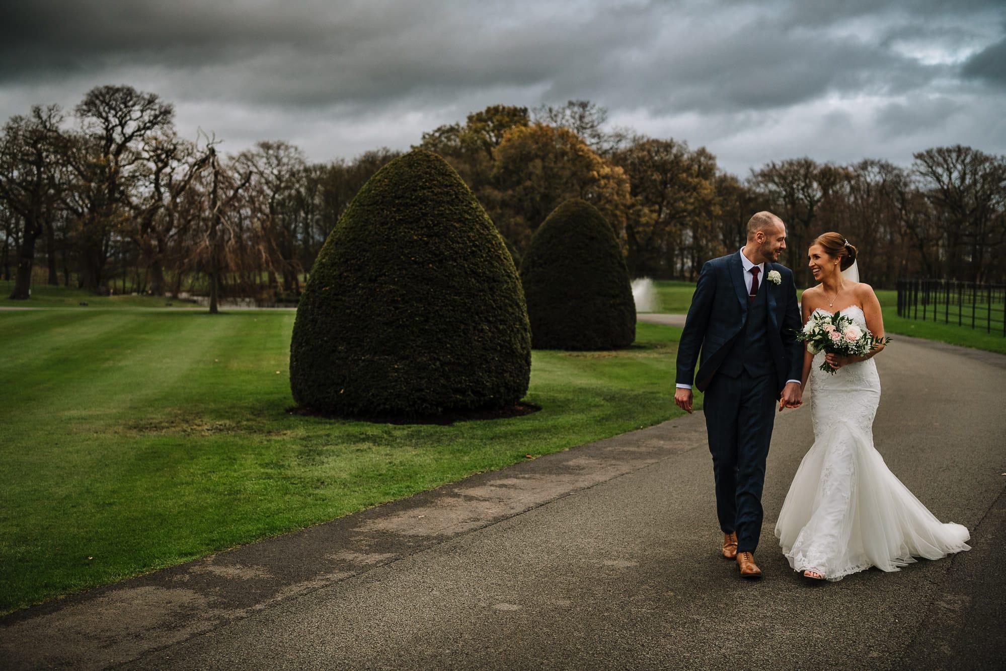 Bride and groom walking at Merrydale Manor