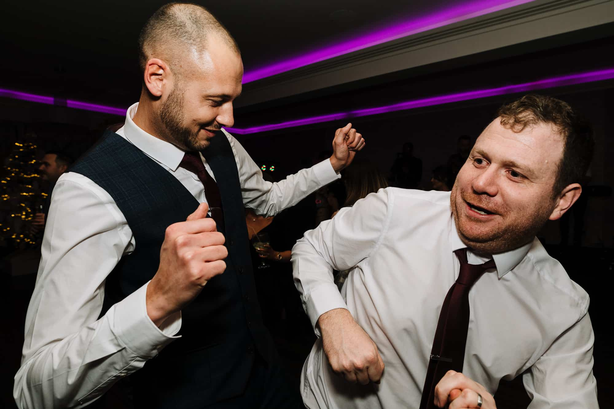 Groom and his best man dancing