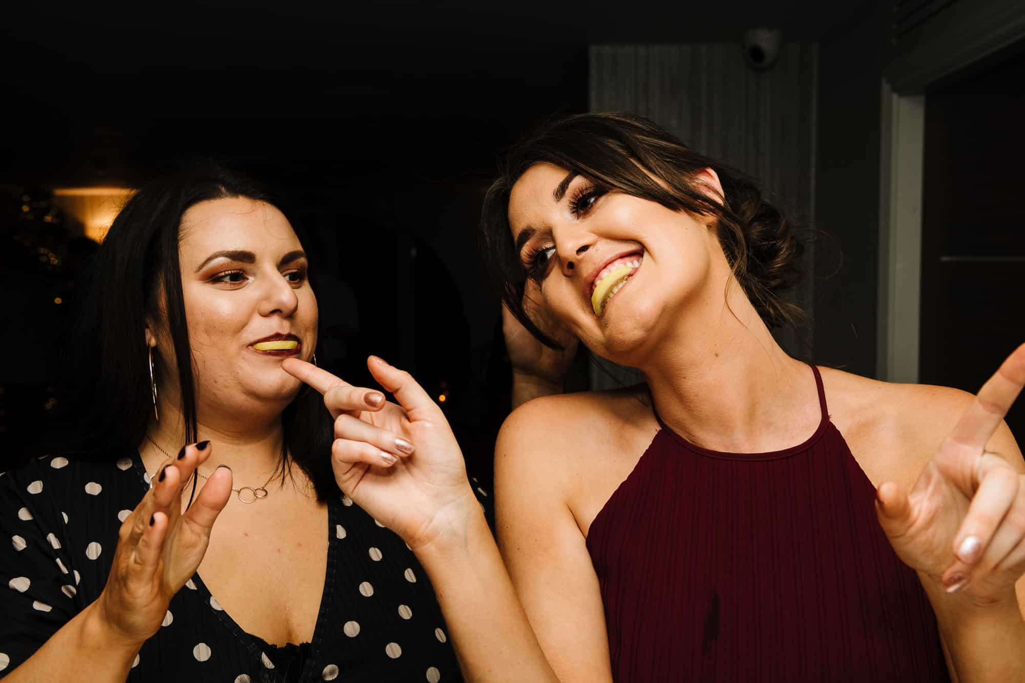 Bridesmaid and friend drinking tequila