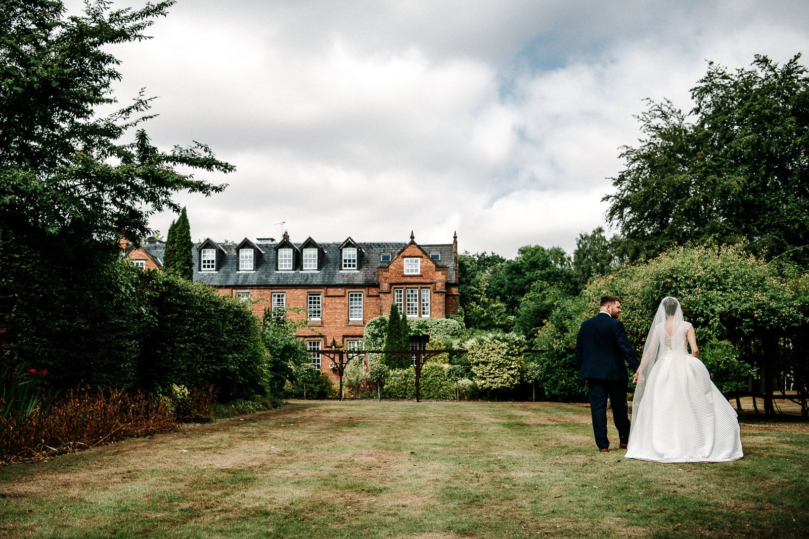 Bride and groom walking in Nunsmere Hall