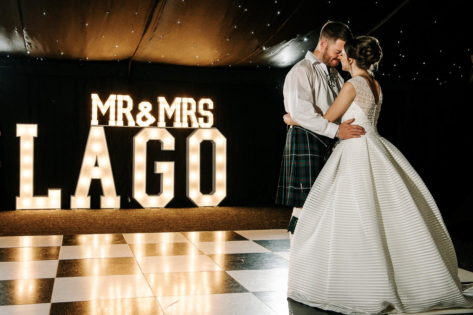 first dance with light up sign behind